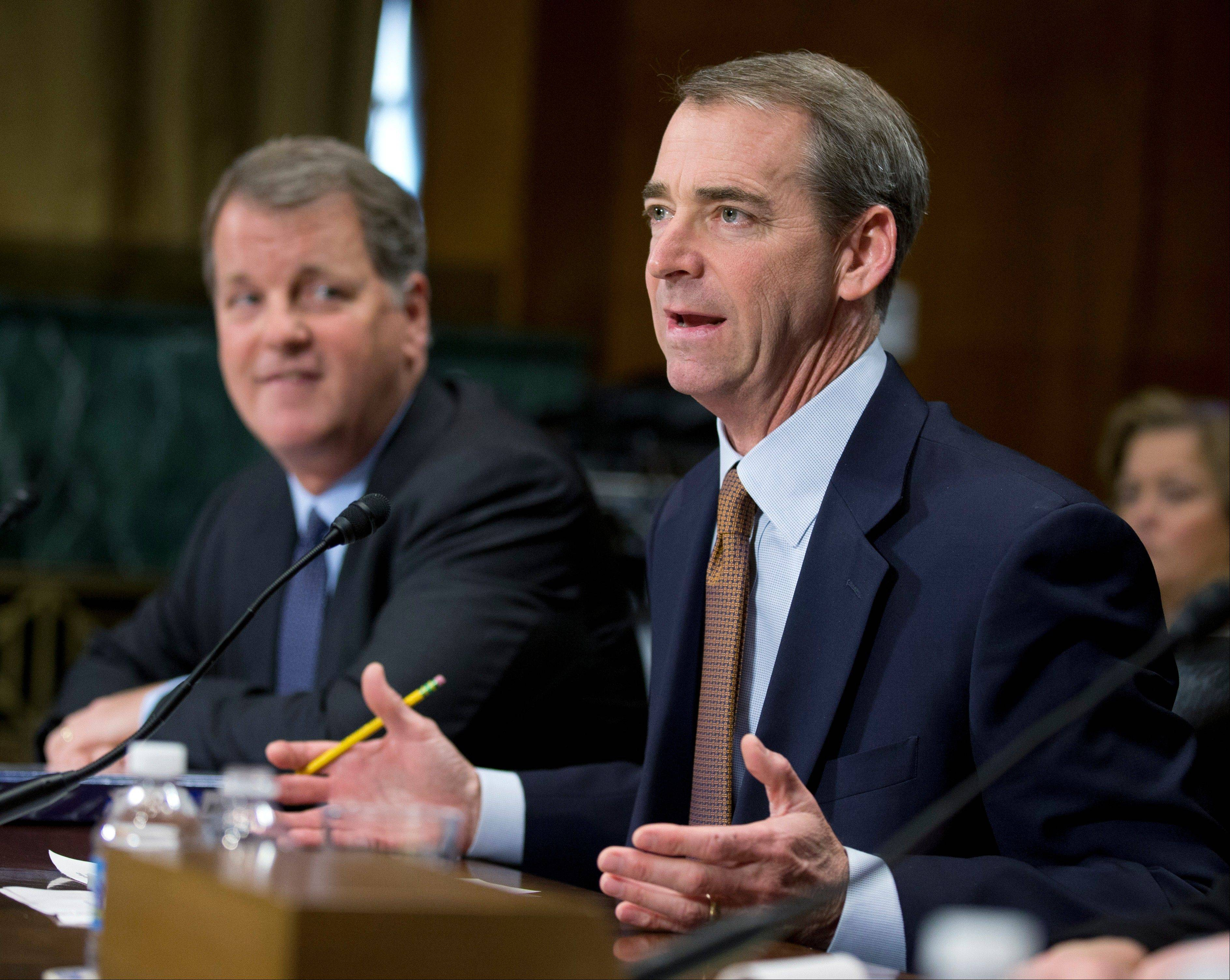 American Airlines and AMR Corporation, Chairman, President and CEO Thomas Horton, right, accompanied by US Airways Group Chairman and CEO Douglas Parker, testifies on Capitol Hill Tuesday before a Senate subcommittee.
