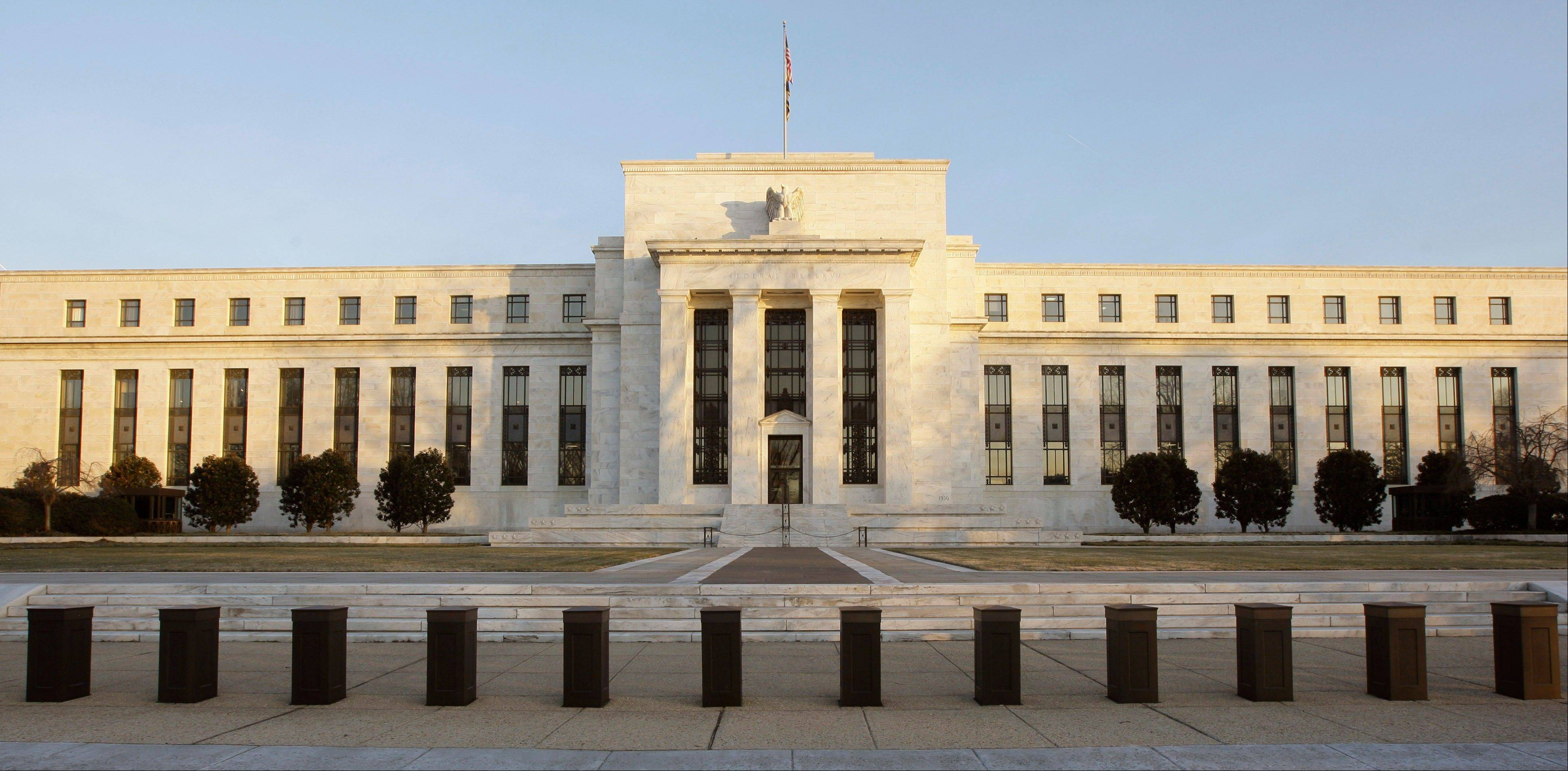 The Federal Reserve Building in Washington. Don't expect the Federal Reserve to let up in its drive to keep stimulating the economy with record-low interest rates. Not yet, anyway.
