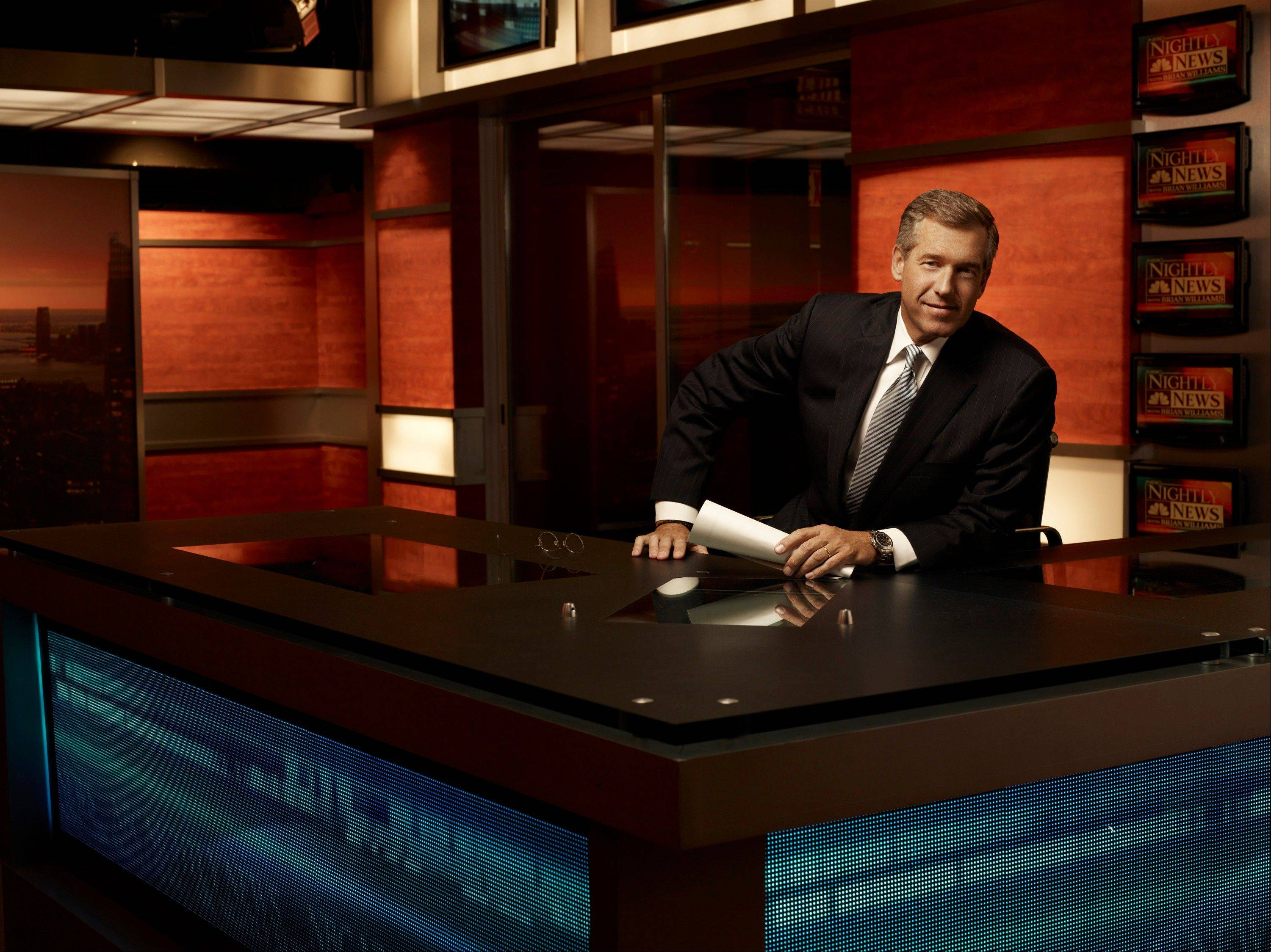 "Brian Williams on the set of ""Nightly News with Brian Williams,"" in New York. ABC, CBS, NBC evening newscasts had 11 percent fewer viewers because of the time change and longer days."
