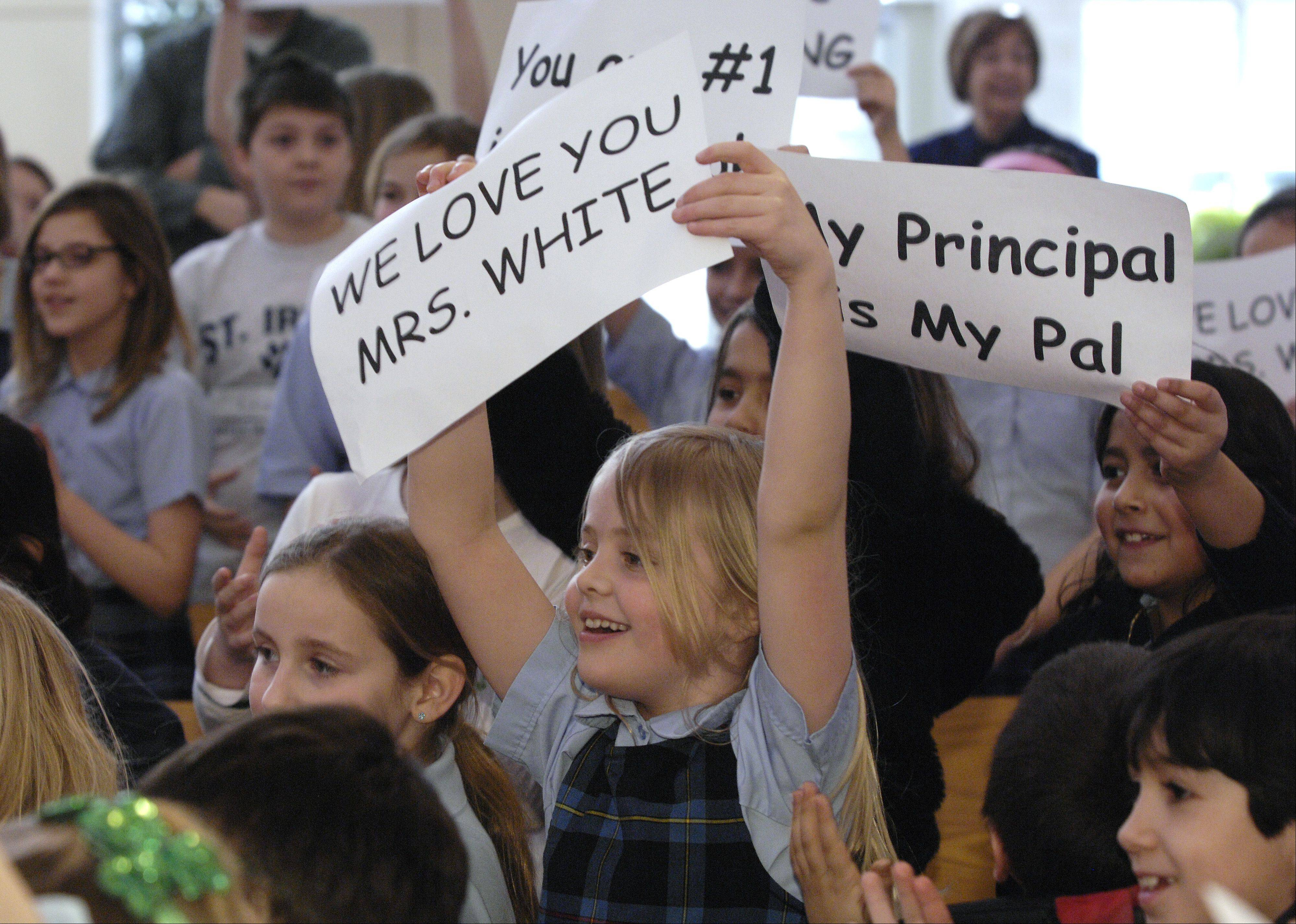 Students from St. Irene School in Warrenville cheer for their principal, Maureen White, after she has received the Diocesan Bishop Kaffer Outstanding Principal Award.