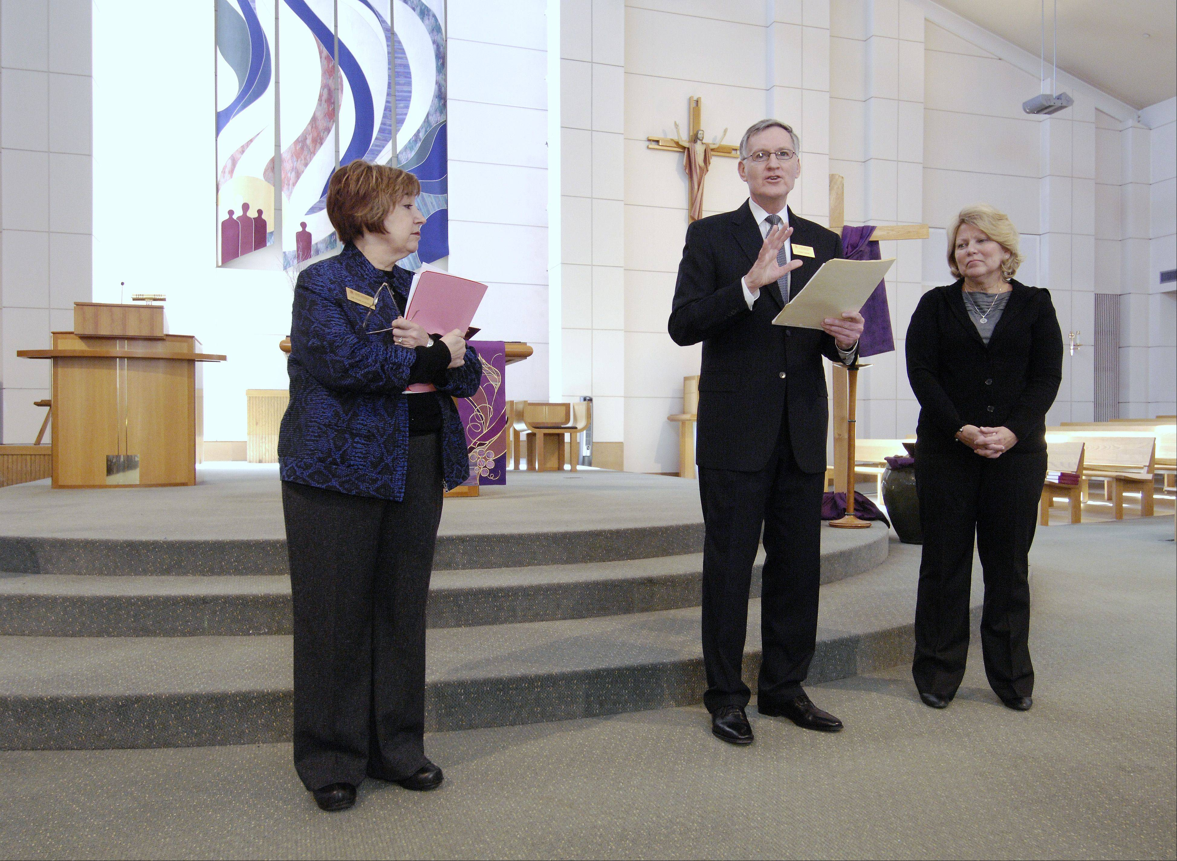 Pamela Jessee and Larry Wiers of Lewis University award St. Irene School Principal Maureen White the Diocesan Bishop Kaffer Outstanding Principal Award.