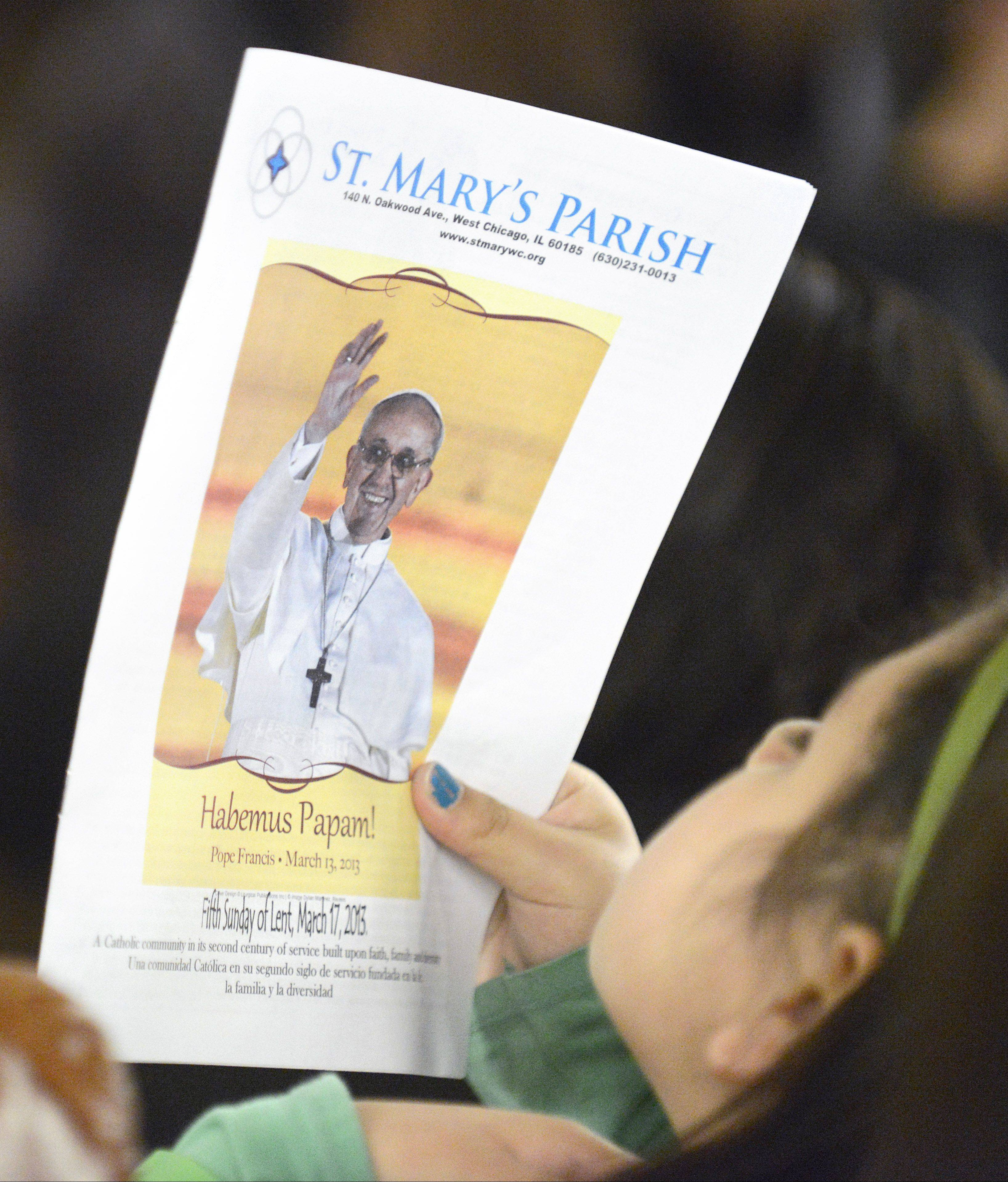 Pope Francis is featured on the weekly bulletin at St. Mary's Parish in West Chicago. The parish's large Latino population is excited about the new pope's Latin American background.