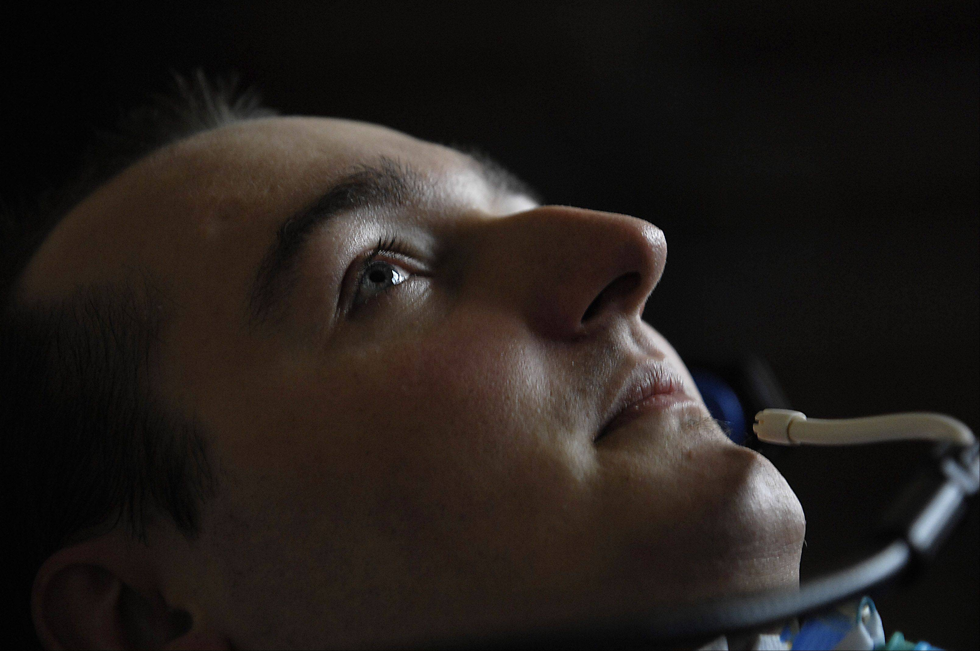 Rob Komosa was able to control his wheelchair by using a sip-n-puff device after the 1999 Rolling Meadows High School football accident that left him a quadriplegic. He died Saturday night at age 30.