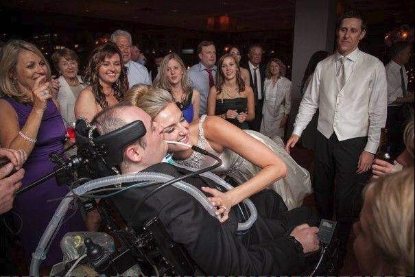 Sharing a special moment at her 2012 wedding, Rob Komosa gets a hug from his sister Ann Phister.