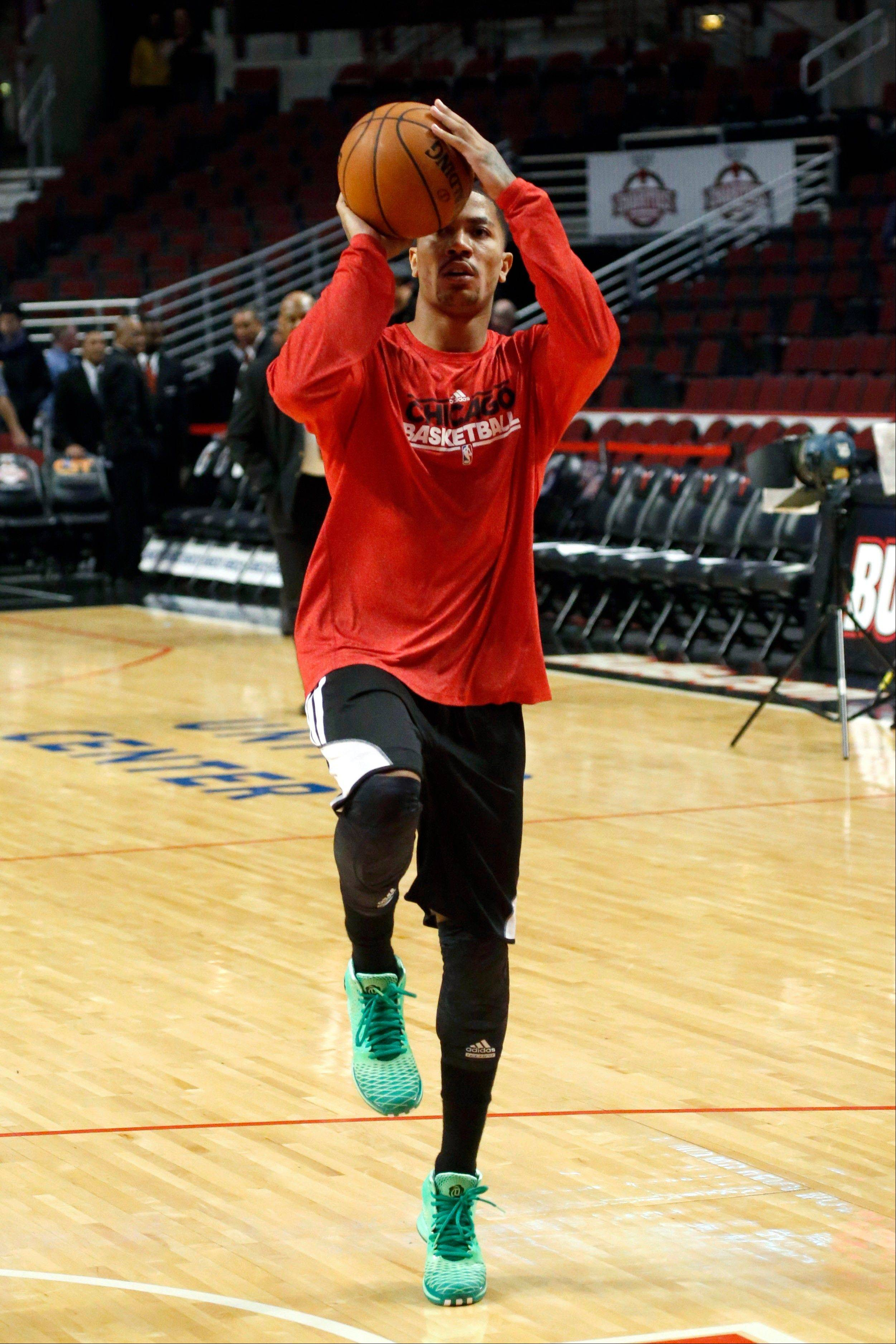 The return of Derrick Rose, here working out before the Bulls' game Monday against the Denver Nuggets, is yet to be determined.