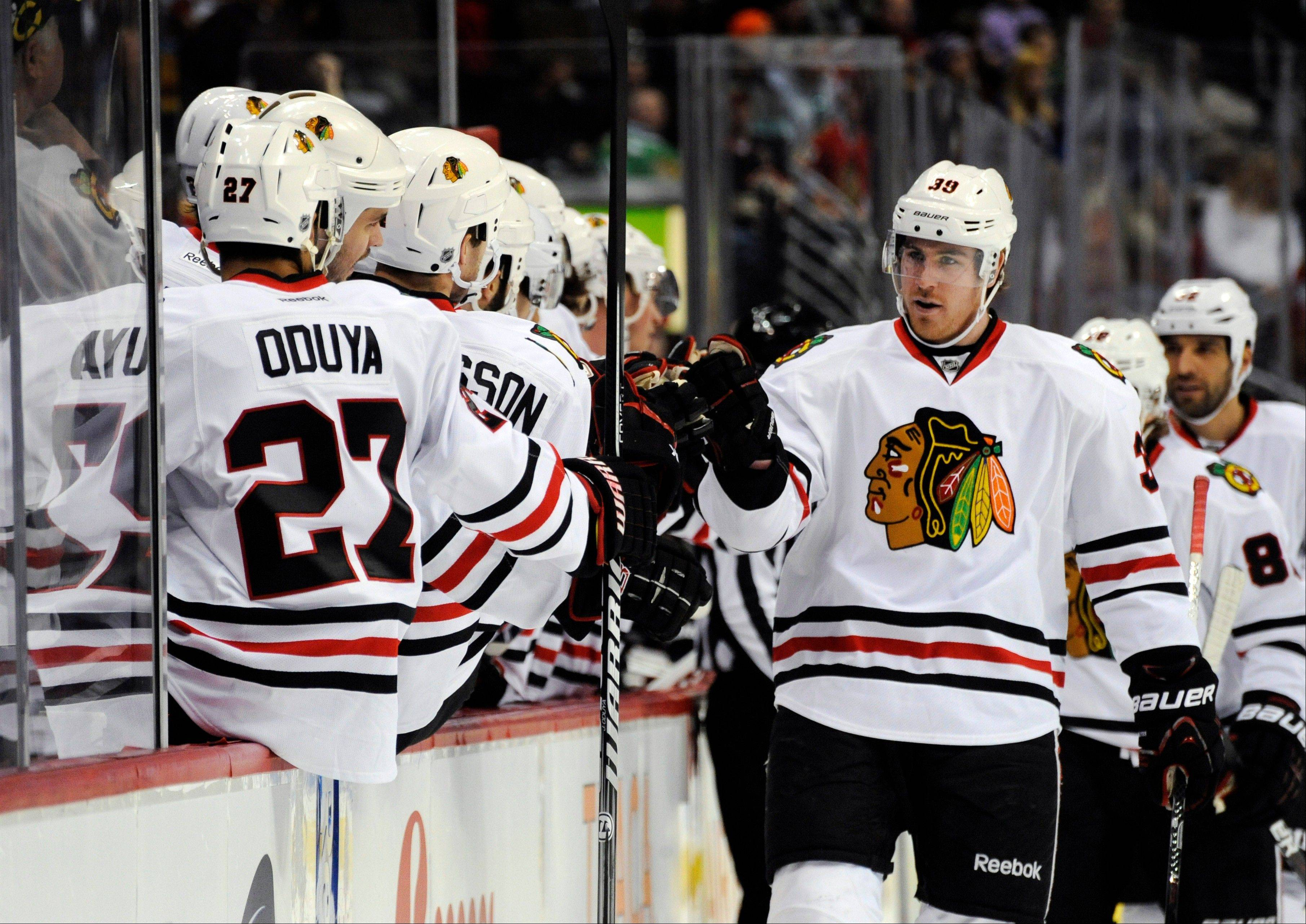 Chicago Blackhawks right wing Jimmy Hayes celebrates a goal against the Colorado Avalanche on Monday. The Hawks have been getting strong contributions from all four lines.