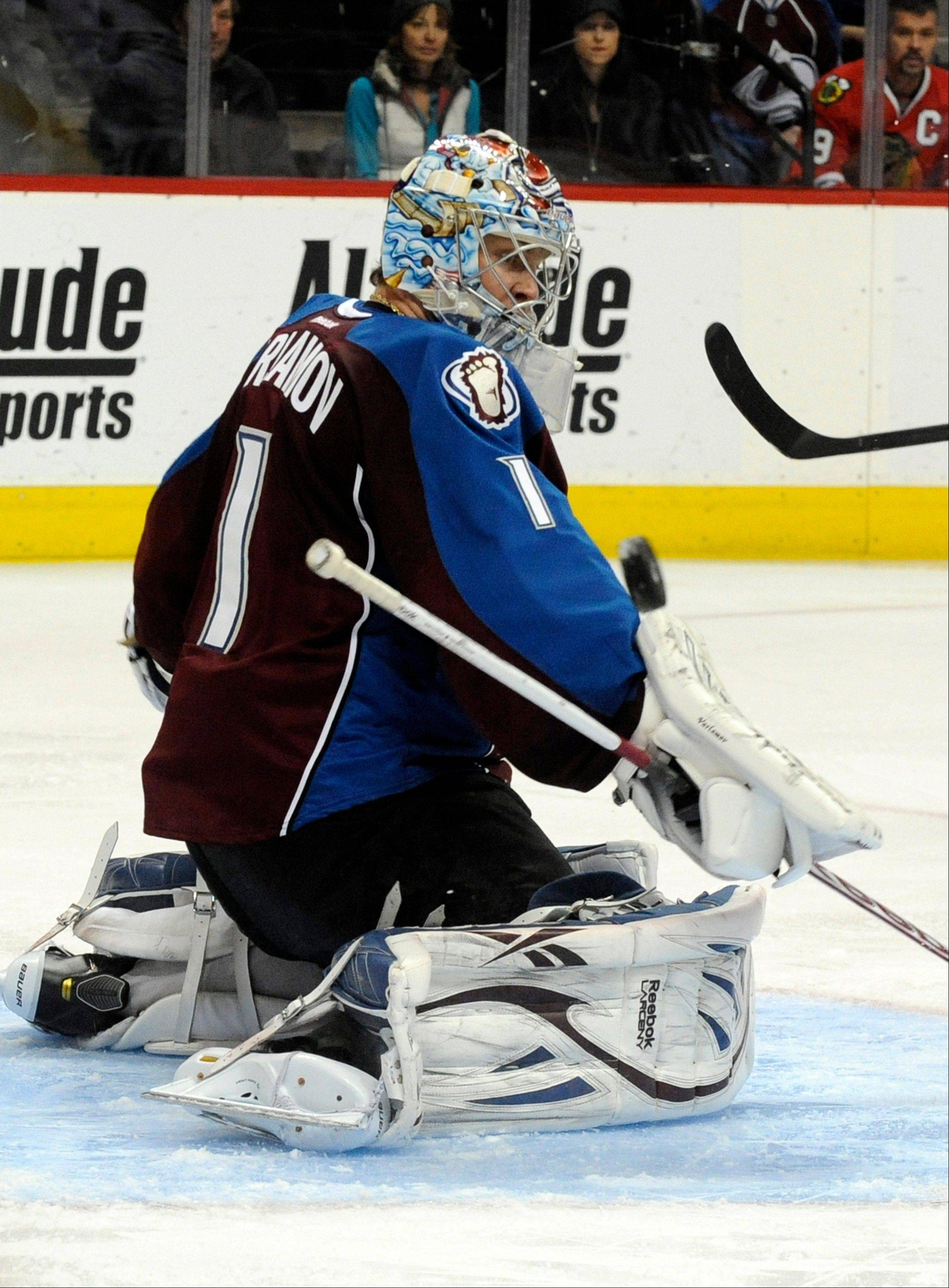 Colorado Avalanche goalie Semyon Varlamov (1), blocks a shot during the second period.
