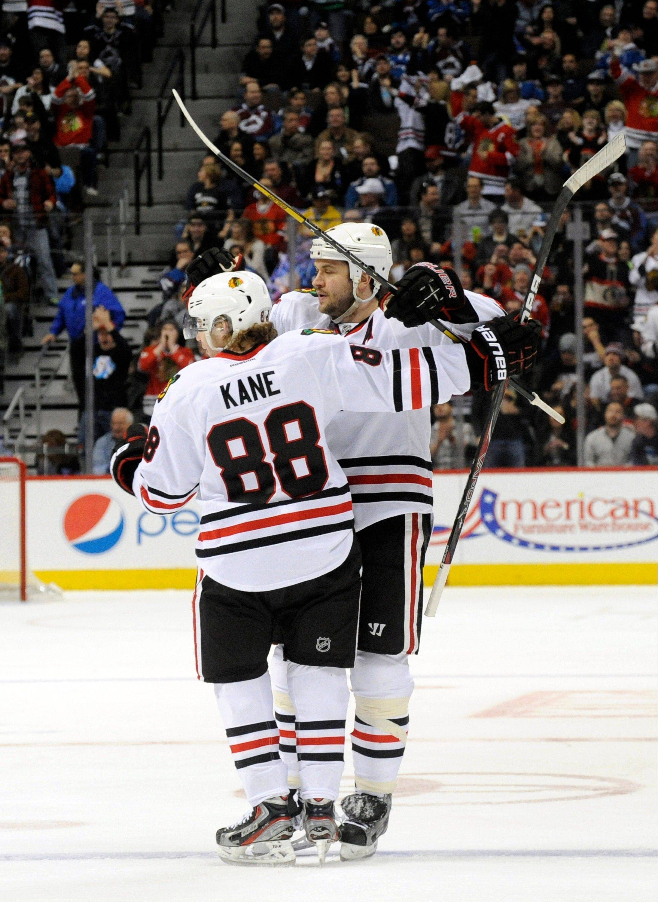 Chicago Blackhawks defenseman Brent Seabrook (7) celebrates his goal against the Colorado Avalanche with Patrick Kane (88) during the second period.