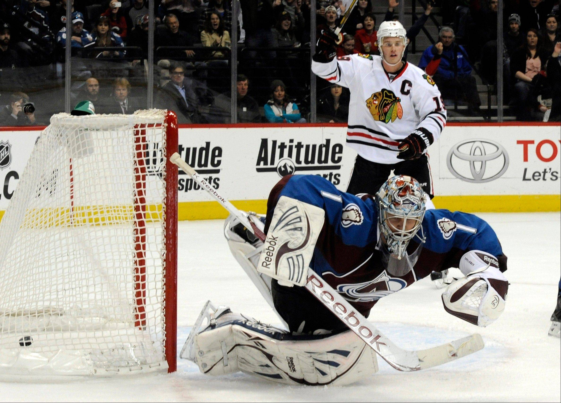 Colorado Avalanche goalie Semyon Varlamov (1), lets the puck slip past for a goal as Chicago Blackhawks center Jonathan Toews (19) celebrates during the second period .