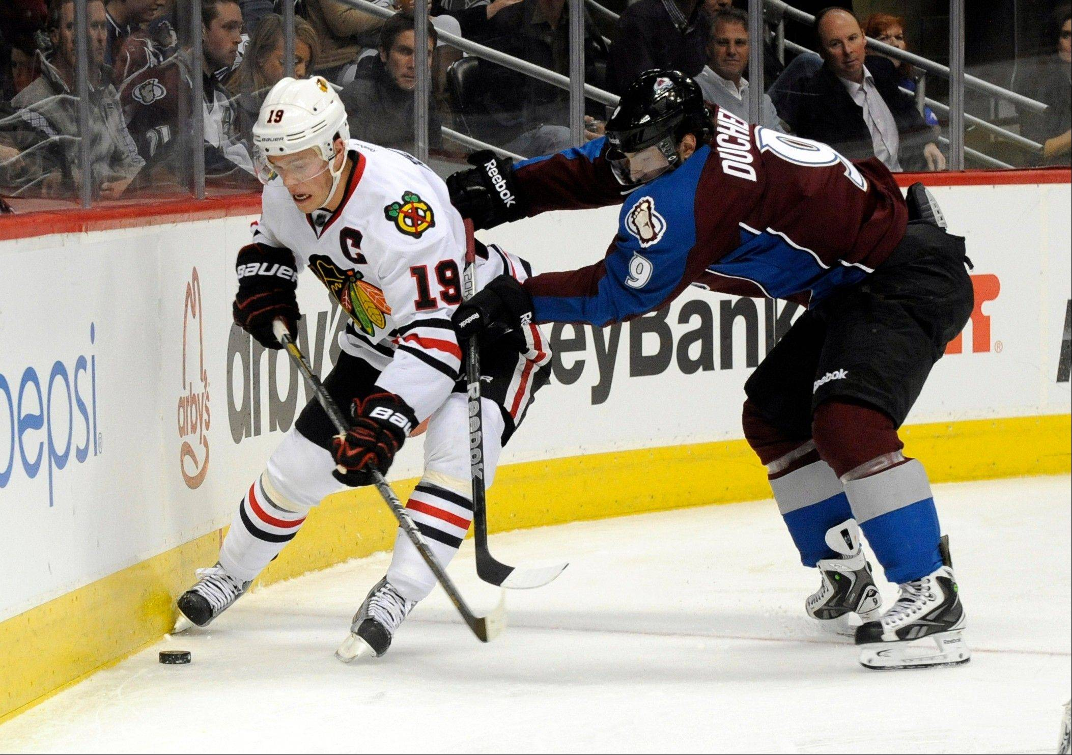 Colorado Avalanche center Matt Duchene (9) and Chicago Blackhawks center Jonathan Toews (19) fight for the puck during the second period .