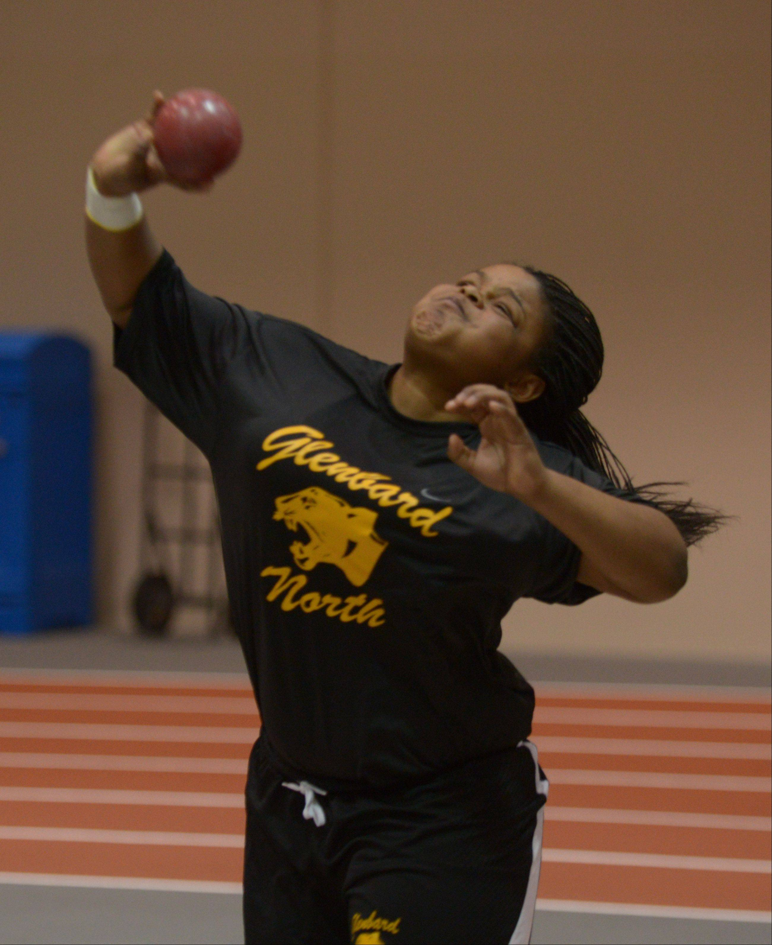 Glenbard North's Tasia Collins competes in the shot put event during the DuPage Valley Conference girls indoor track meet at North Central College Thursday.