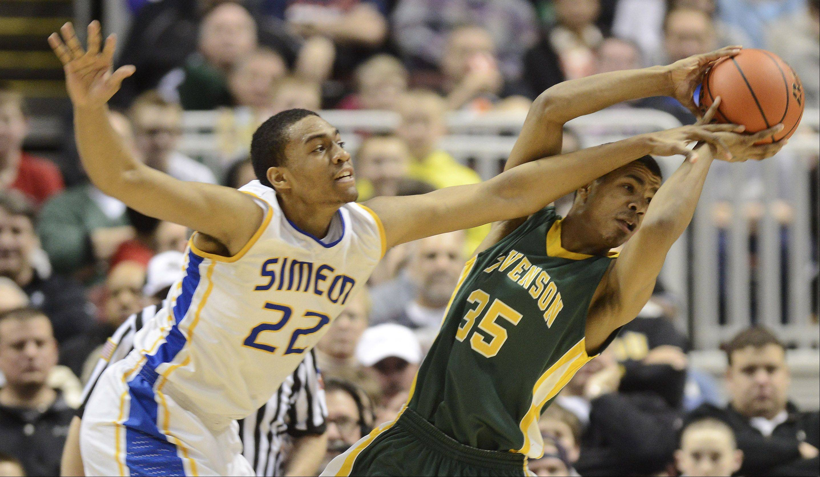 Stevenson's Connor Cashaw draws contact from Simeon's Jabari Parker during the class 4A boys basketball state finals at the Carver Arena in Peoria Saturday.