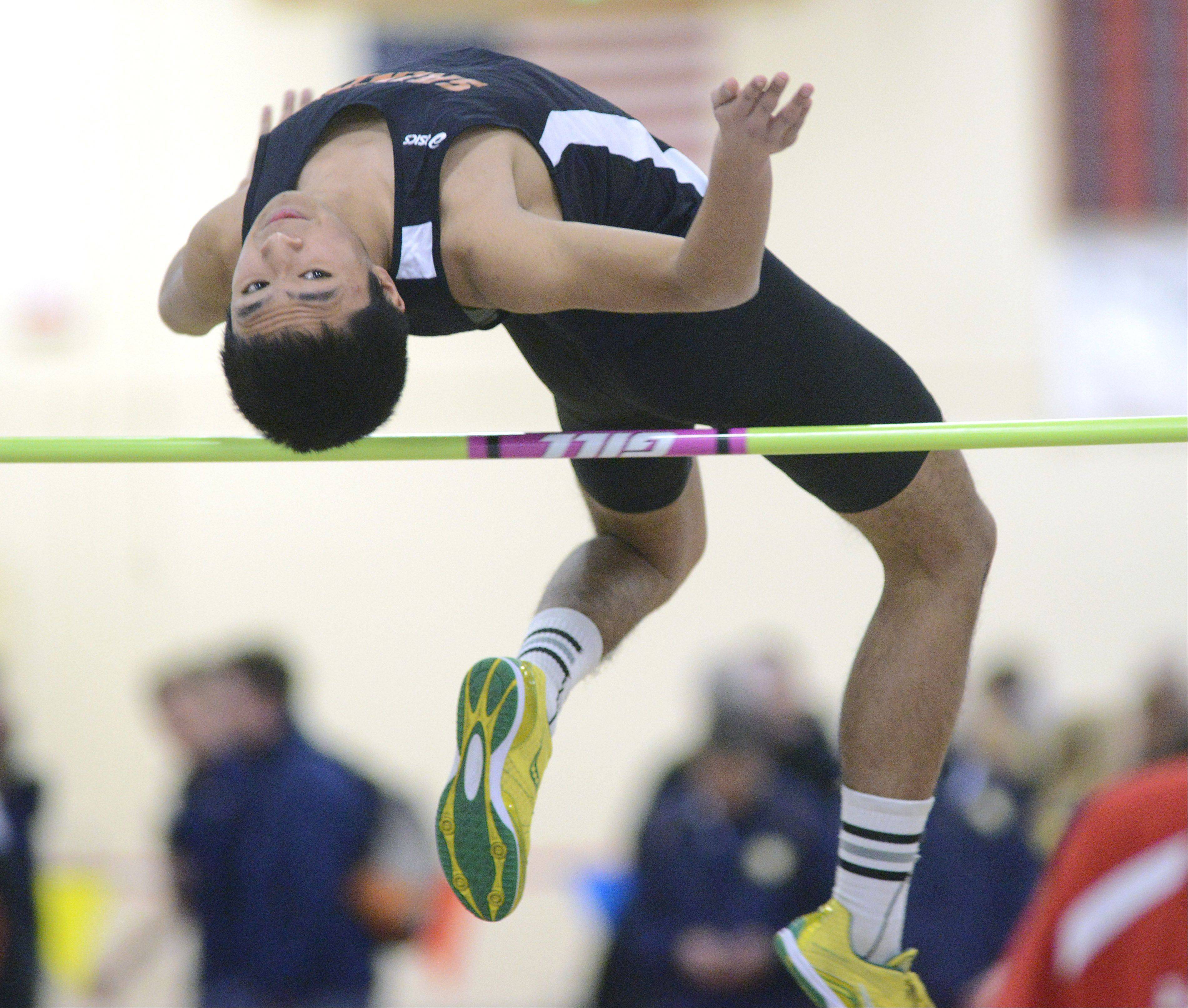 St. Charles East's Ryan Memije competes in the high jump finals at the Upstate Eight Conference in Batavia on Saturday.