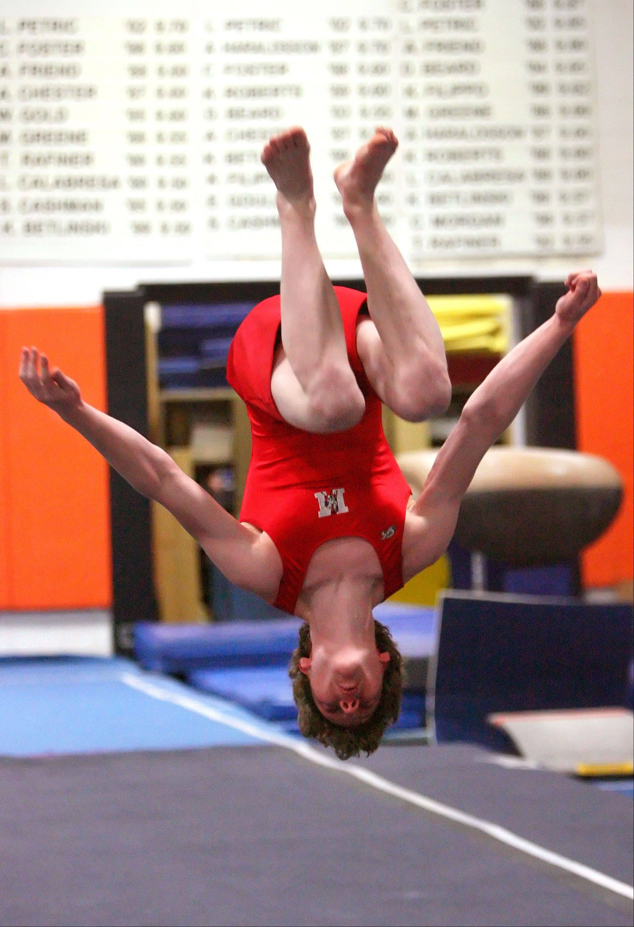 Mundelein's Jacob Petri competes on the floor exercise during Tuesday's meet at Libertyville High School.