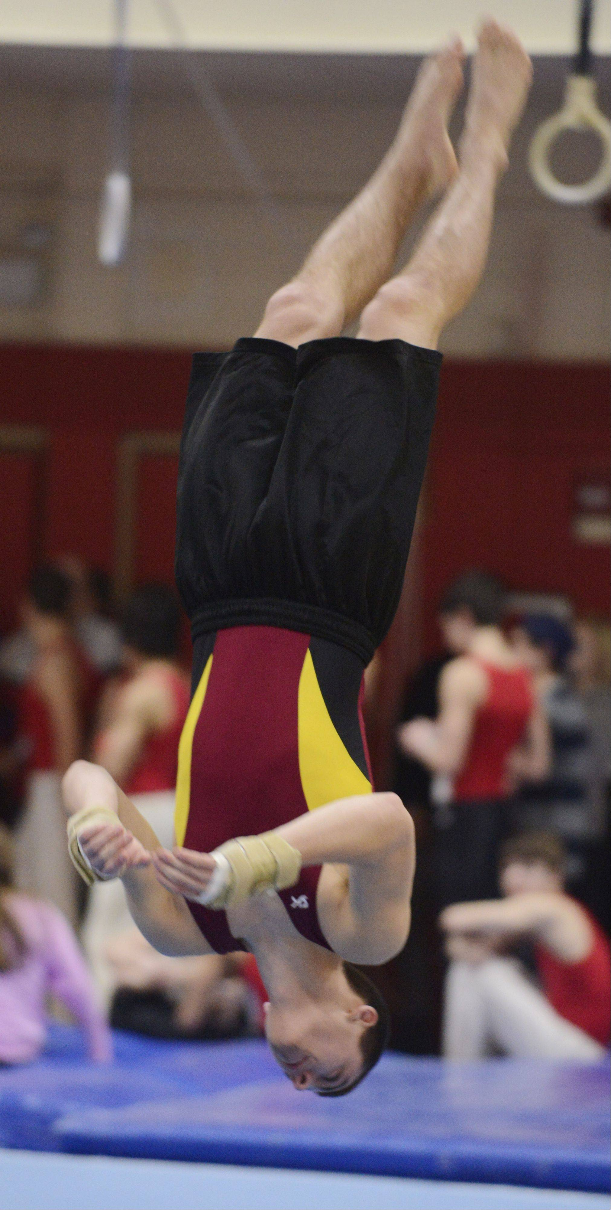 Schaumburg's Mat Sigler competes on the floor exercise during Wednesday's boys gymnastics triangular meet at Schaumburg.