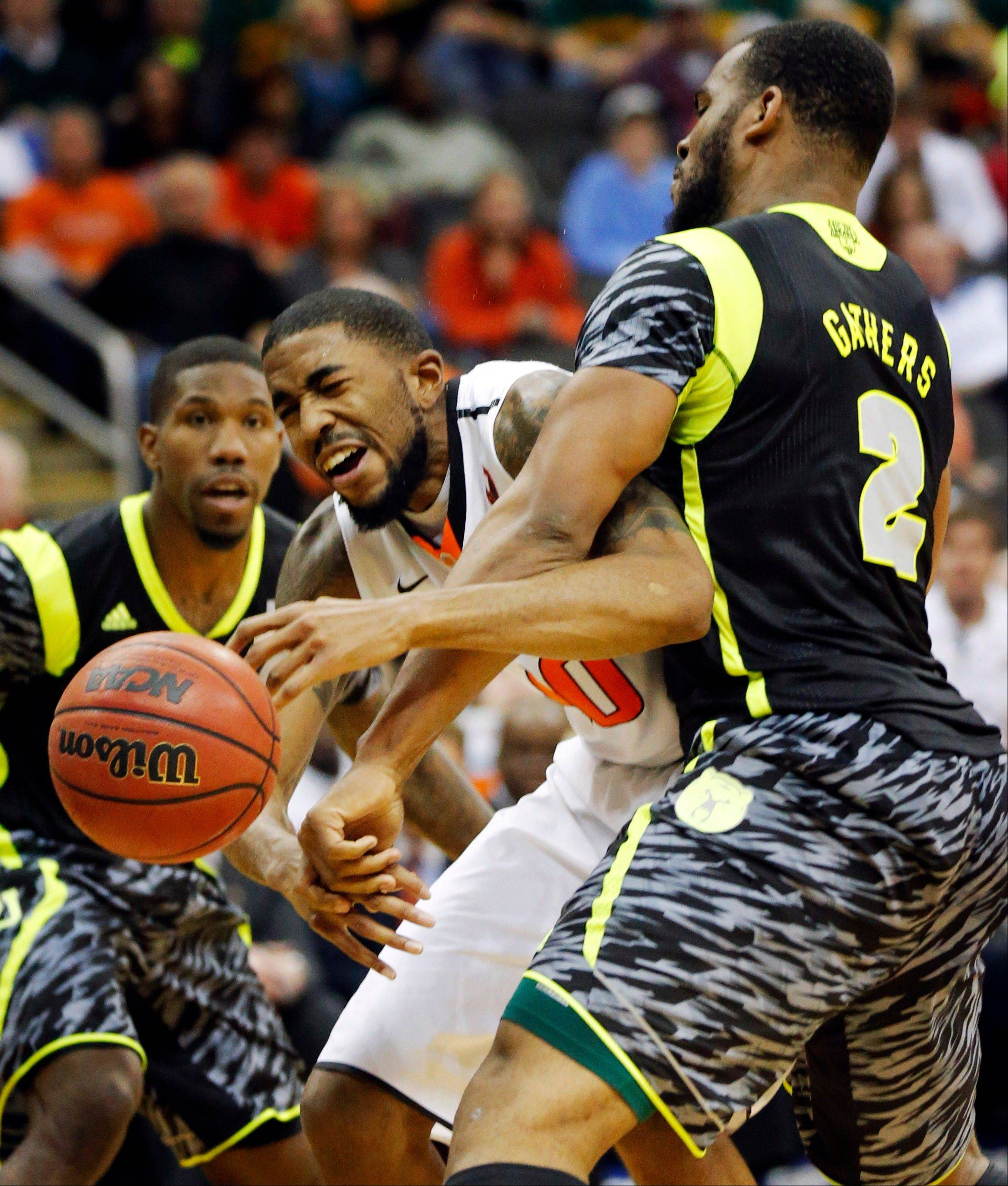 This March 14 photo shows Oklahoma State playing Baylor in their Big 12 tournament in Kansas City, Mo. The neon-colored jerseys and camouflage-covered shorts debuted by six teams in their post-season conference championships ahead of the NCAA men�s basketball tournament weren�t well received in the press and social media.