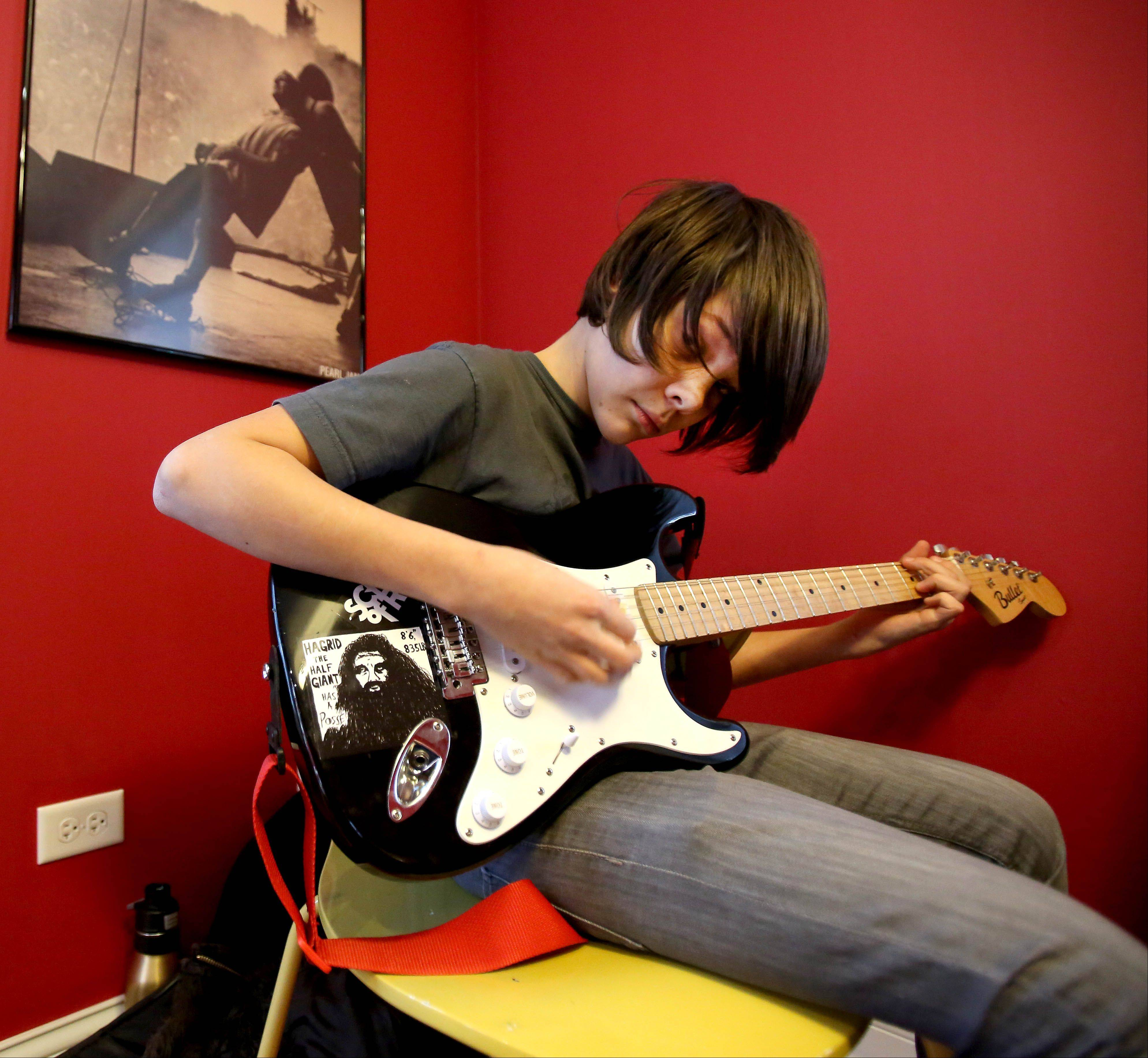 Elliott Dombrowski, 13, of Bolingbrook puts in some guitar practice at the School of Rock in Naperville.