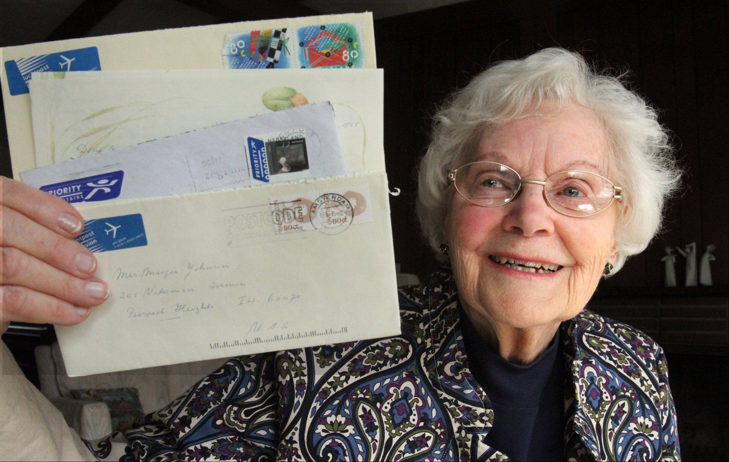 Marge Johnson of Prospect Heights holds letters showing she has been corresponding with a pen pal in Holland since 1938.