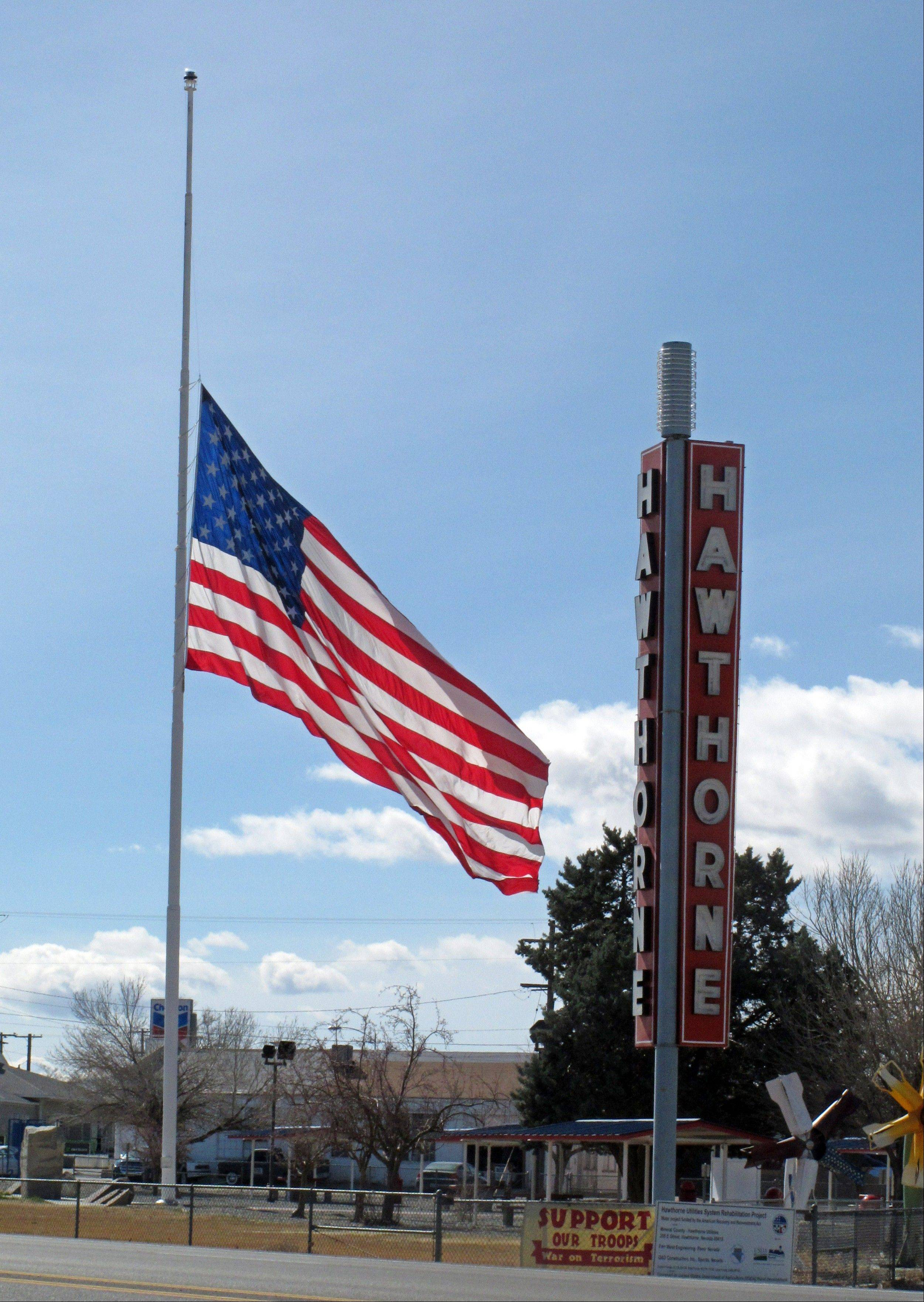 An American flag waves at half staff in the town of Hawthorne near the Hawthorne Army Depot on Tuesday, March 19, 2013, where seven Marines were killed and several others seriously injured in a training accident Monday night, about 150 miles southeast of Reno in Nevada�s high desert.