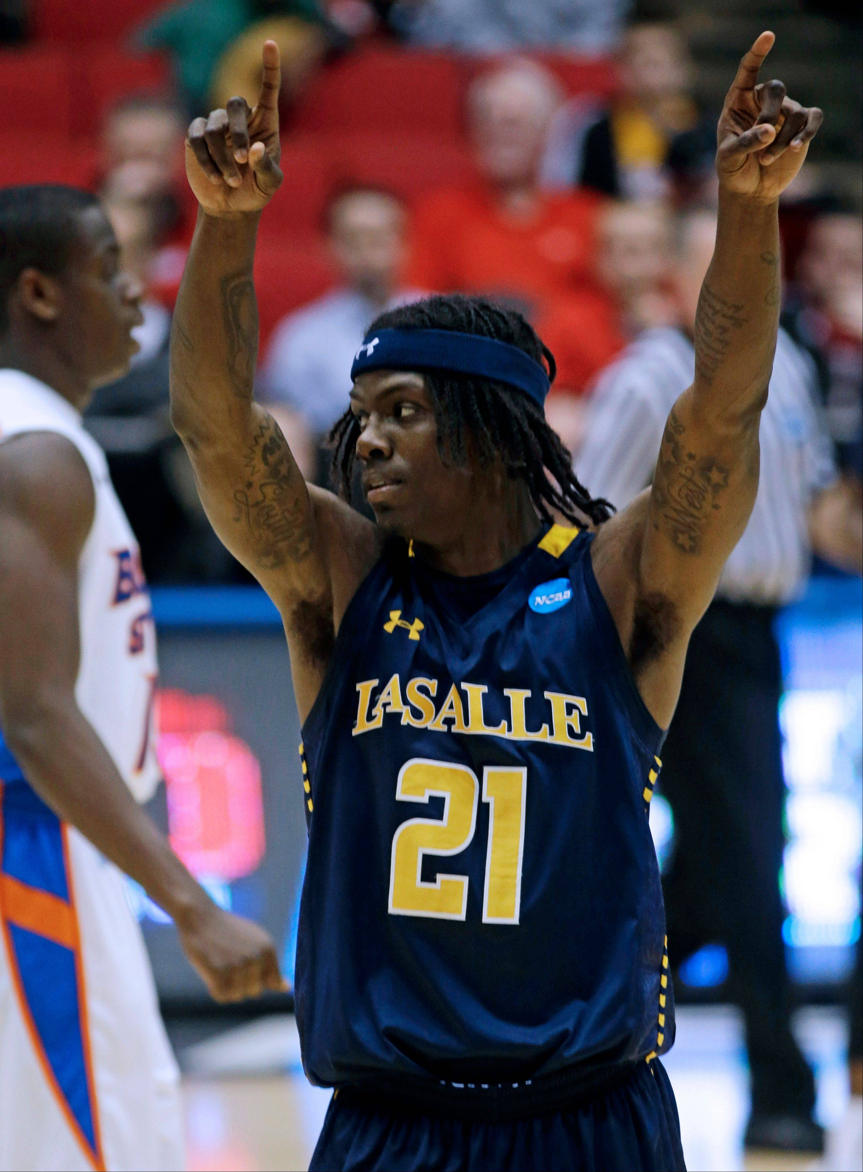 La Salle guard Tyrone Garland (21) celebrates after defeating Boise State 80-71 in a first-round game of the NCAA college basketball tournament, Wednesday, March 20, 2013, in Dayton, Ohio. Garland led La Salle with 22 points. (AP Photo/Al Behrman)