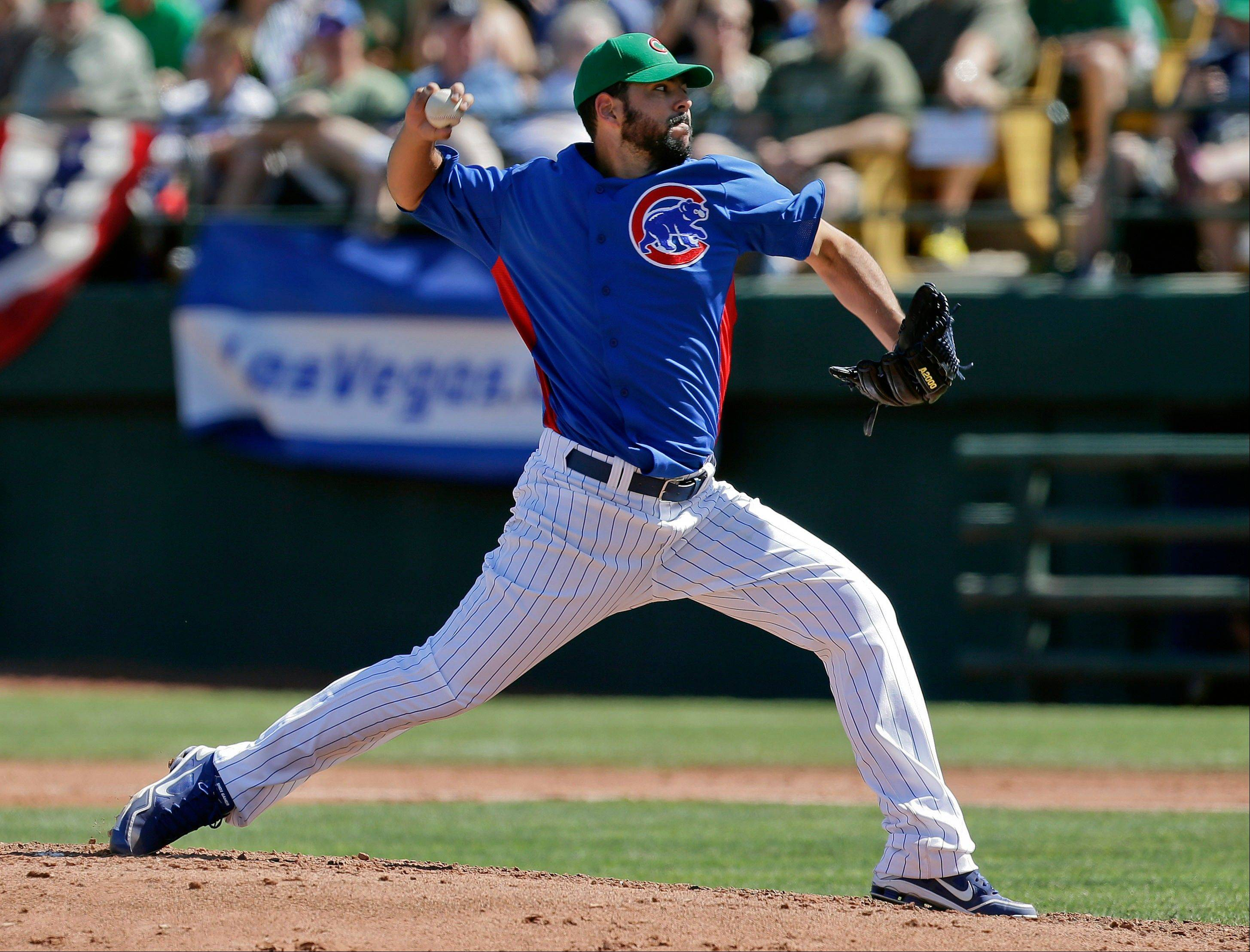 Chicago Cubs pitcher Carlos Villanueva delivers against the Texas Rangers in the fourth inning of an exhibition spring training baseball game, Sunday, March 17, 2013, in Las Vegas. (AP Photo/Julie Jacobson)