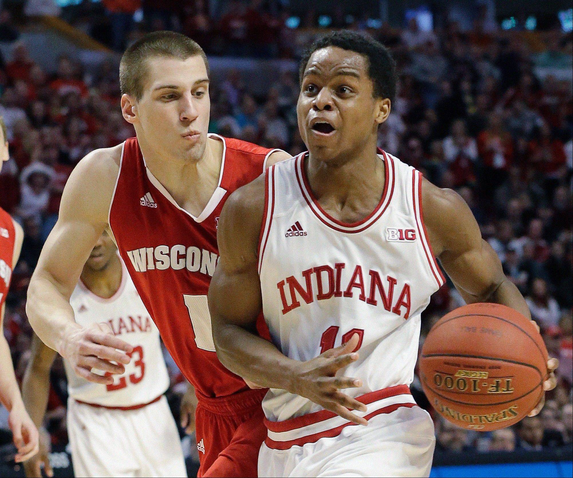 Indiana's Yogi Ferrell tries to drive past Wisconsin's Ben Brust. President Barack Obama is picking Indiana to win the NCAA title.