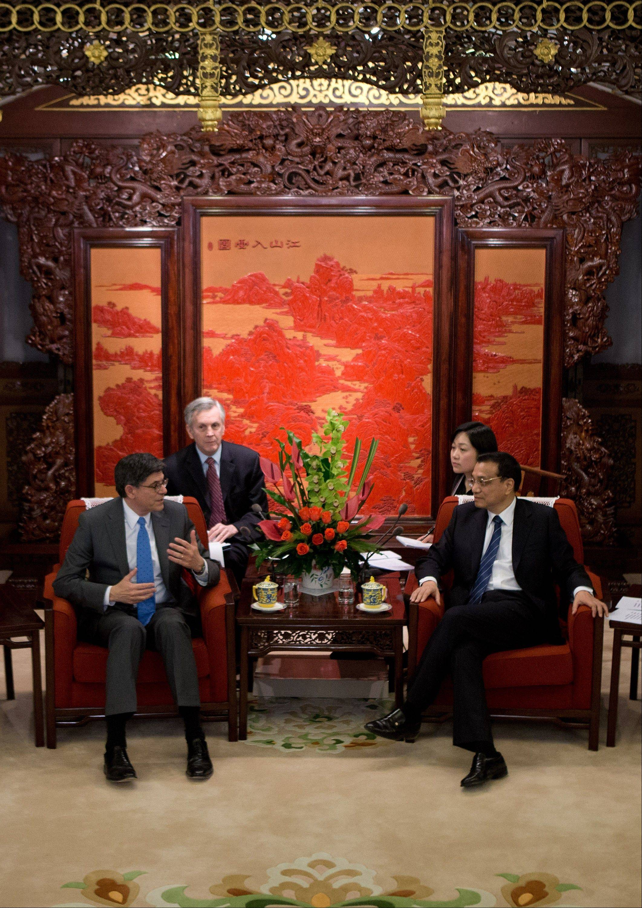 U.S. Treasury Secretary Jacob Lew speaks with Chinese Premier Li Keqiang during their meeting at the Zhongnanhai diplomatic compound in Beijing Wednesday.