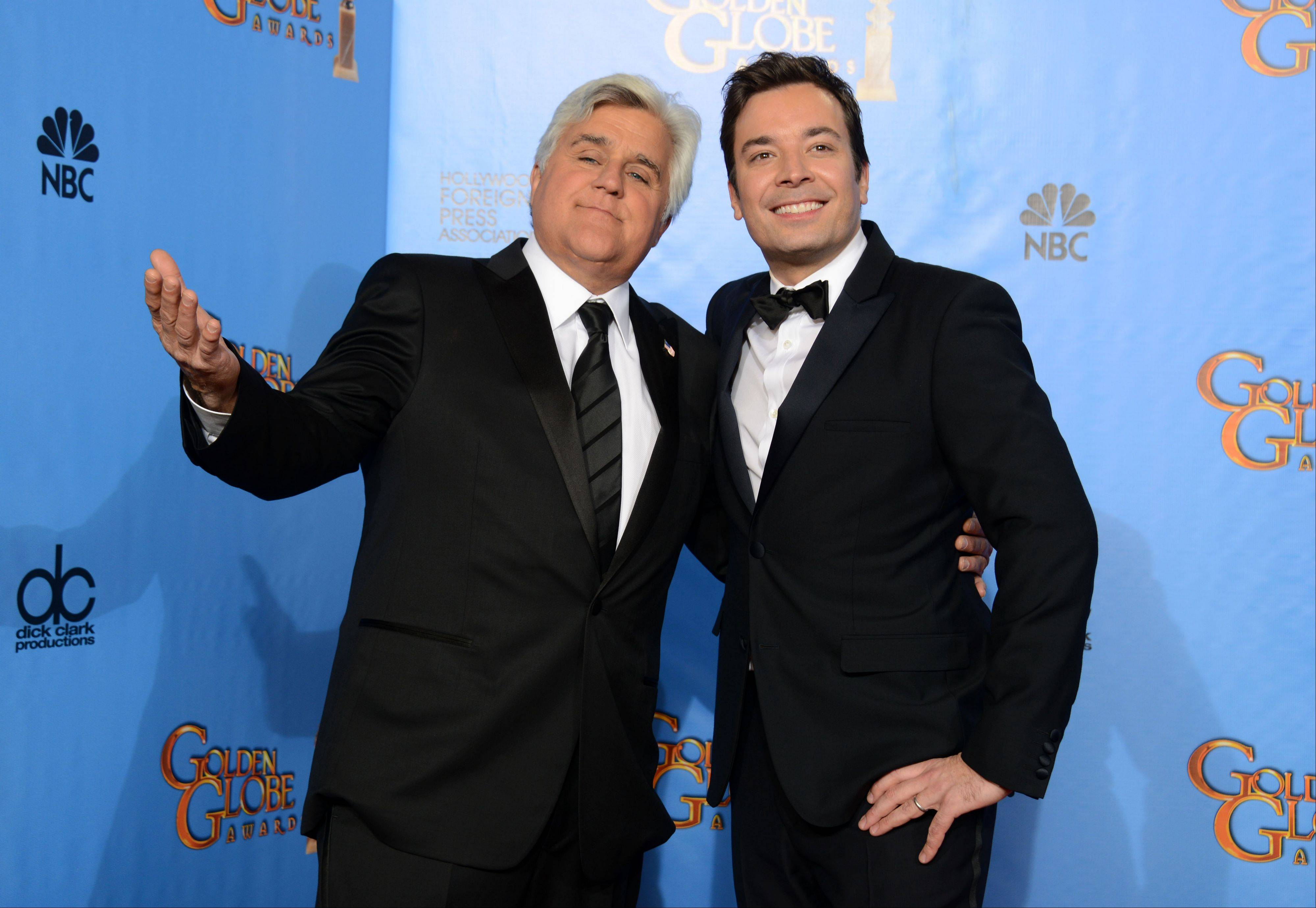 "This Jan. 13 file photo shows Jay Leno, host of ""The Tonight Show with Jay Leno,"" left, and Jimmy Fallon, host of ""Late Night with Jimmy Fallon"" backstage at the 70th Annual Golden Globe Awards in Beverly Hills, Calif. As Jay Leno lobs potshots at ratings-challenged NBC in his ""Tonight Show"" monologues, speculation is swirling the network is taking steps to replace the host with Jimmy Fallon next year and move the show from Burbank to New York."