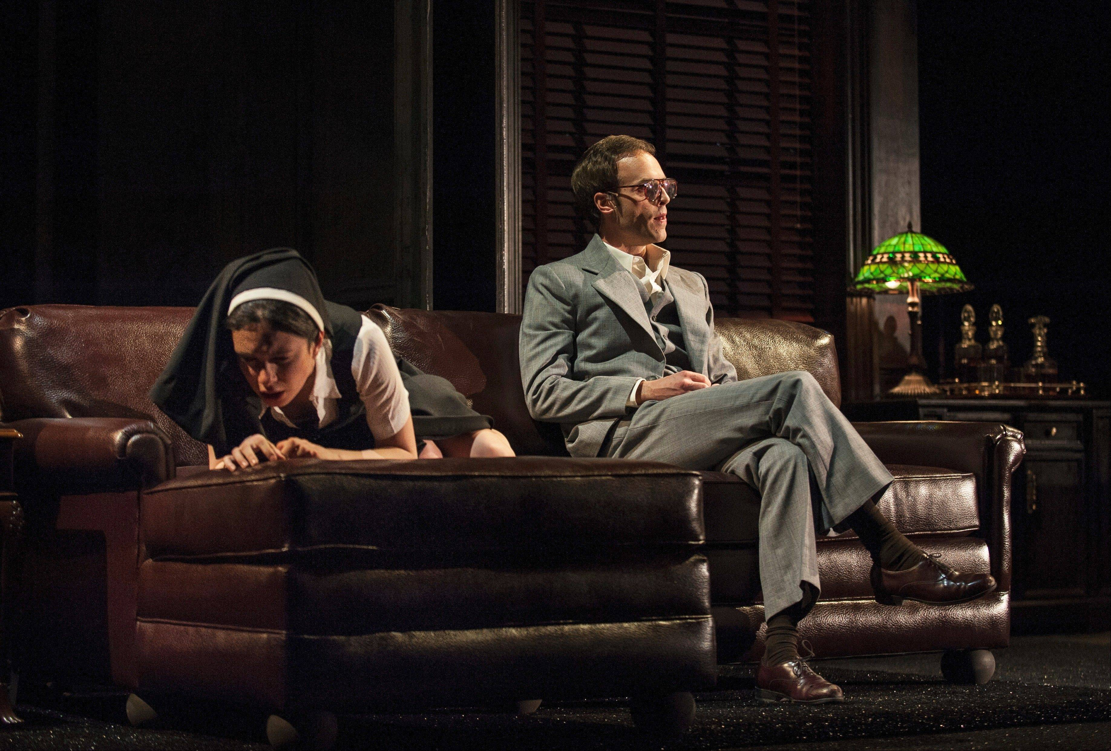 "The deputy Angelo (Jay Whittaker) sits back after making an untoward advance on the novice nun Isabella (Alejandra Escalante) in Robert Falls' 1970s New York-inspired take on Shakespeare's ""Measure for Measure"" at the Goodman Theatre in Chicago."