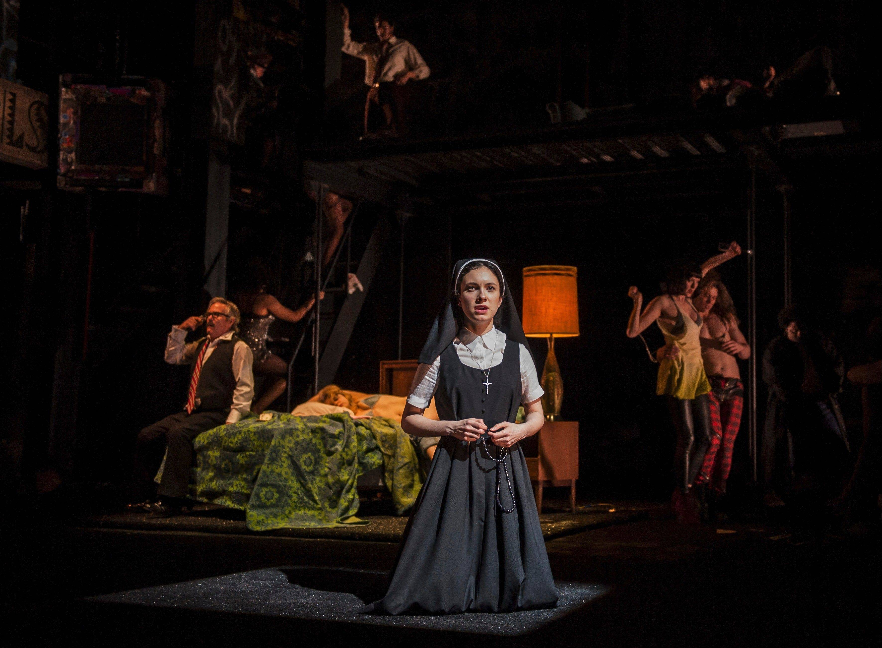 "Isabella, a novice nun (Alejandra Escalante), prays in the opening sequence of Robert Falls' 1970s New York-inspired take on Shakespeare's ""Measure for Measure"" at the Goodman Theatre in Chicago."