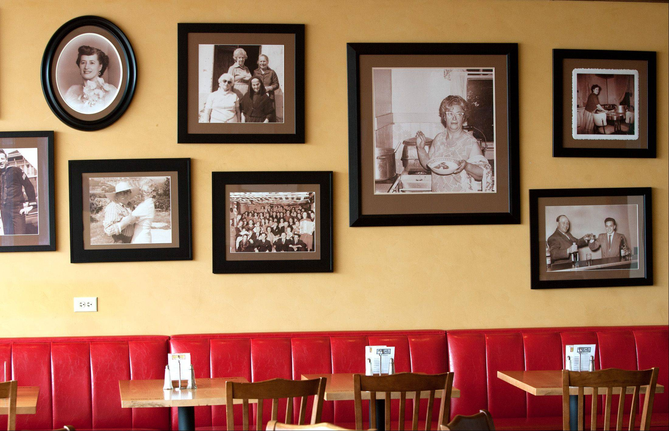 A sleek, contemporary setting is made cozy with dimmed lighting and family photos at Ravioli Oli in Oak Brook.