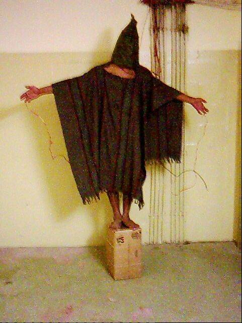 FILE - This late 2003 image obtained by The Associated Press shows an unidentified detainee standing on a box with a bag on his head and wires attached to him at the Abu Ghraib prison in Baghdad, Iraq.