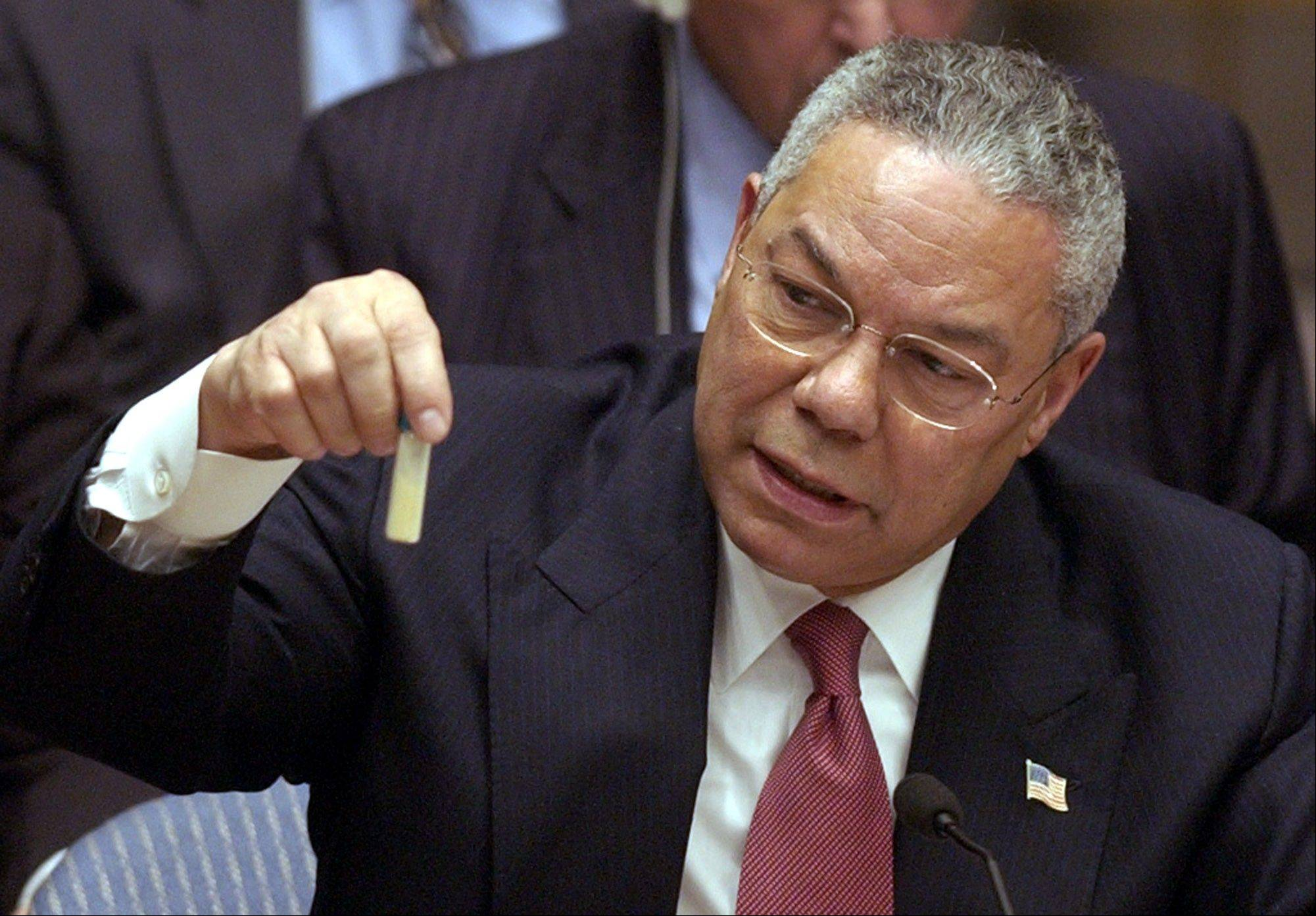 FILE - U.S. Secertary of State Colin Powel holds up a vial that he said could contain anthrax during a meeting of the United Nations Security Council at the United Nations headquarters on Wednesday, Feb. 5, 2003.