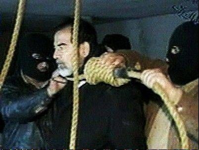 FILE - This image made from video released by Iraqi state television shows Saddam Hussein's guards wearing ski masks and placing a noose around the deposed leader's neck moments before his execution on Saturday, Dec. 30, 2006.