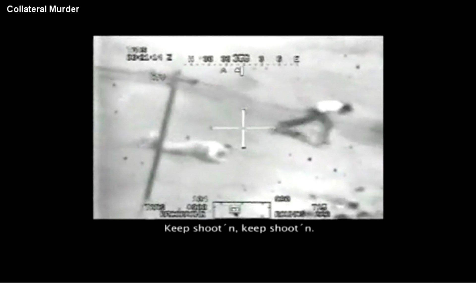 FILE - This image made from a video from a U.S. Army Apache helicopter gun sight, posted at Wikileaks.org and confirmed as authentic by a senior U.S. military official, shows two men in the streets of the New Baghdad district of eastern Baghdad after being fired upon by the helicopter on July 12, 2007. Among those killed in the attack was Reuters photographer Namir Noor-Eldeen, 22, and his driver Saeed Chmagh, 40. Two children also were wounded.