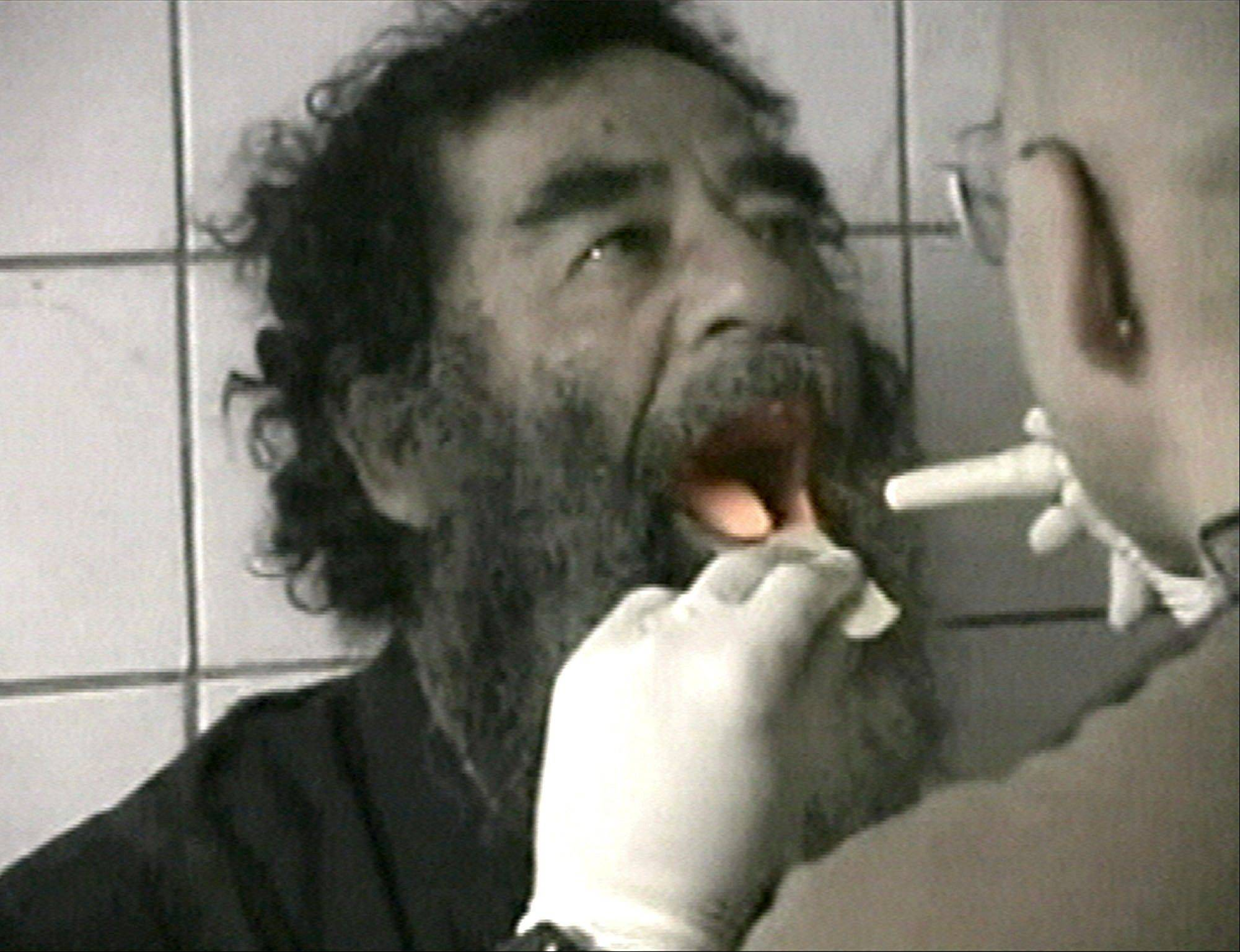 FILE - Captured former Iraqi leader Saddam Hussein undergoes a medical examination in Baghdad on Dec. 14, 2003 in this image made from video.