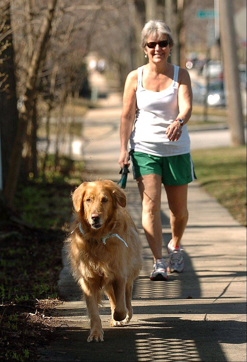 Deb Short took advantage of temperatures in the 80s to take a stroll in downtown Barrington in March 2012.