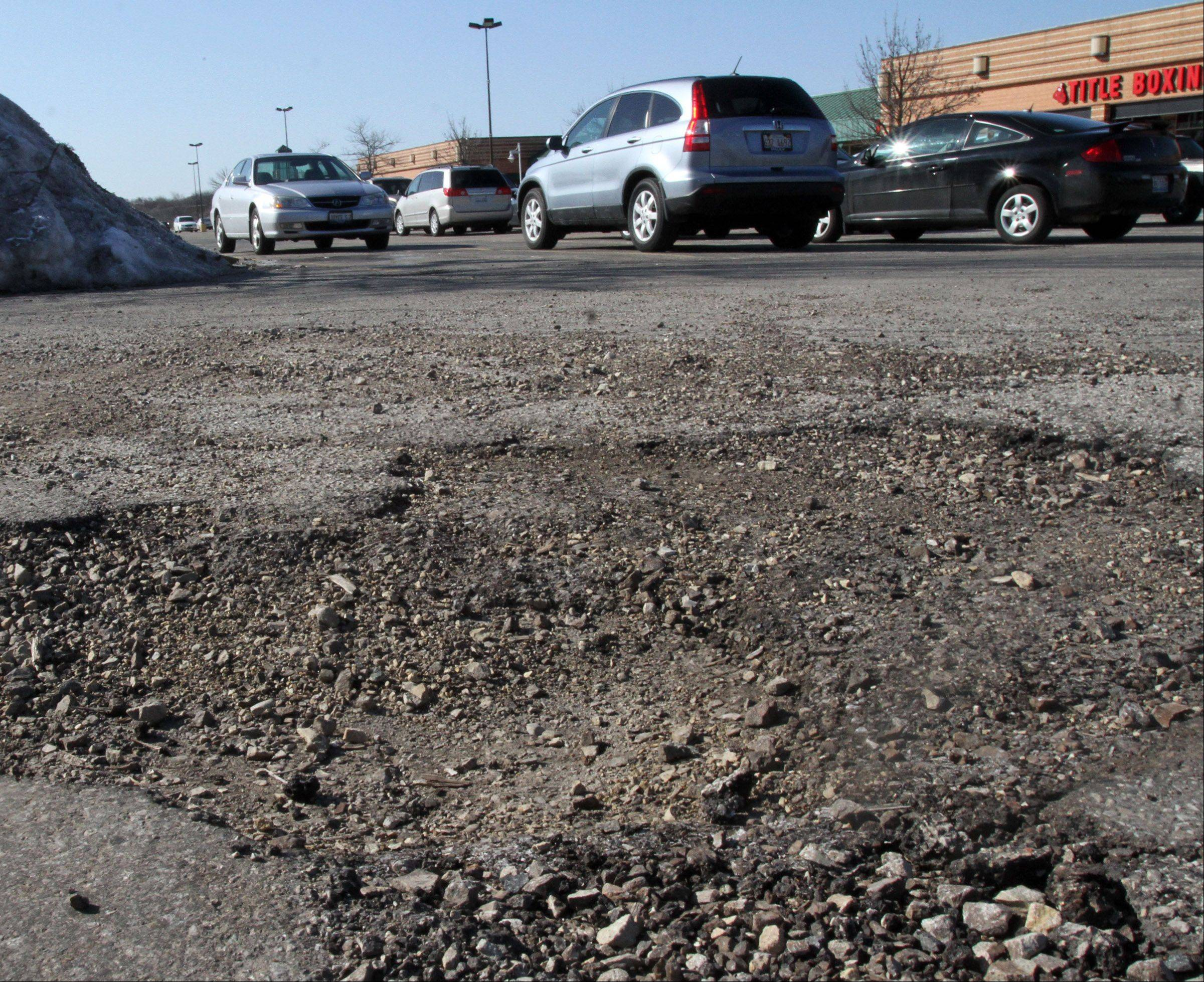 This is a pothole in the parking lot at Buffalo Grove Town Center at Lake-Cook Road and McHenry Road in Buffalo Grove on Wednesday, March 20.