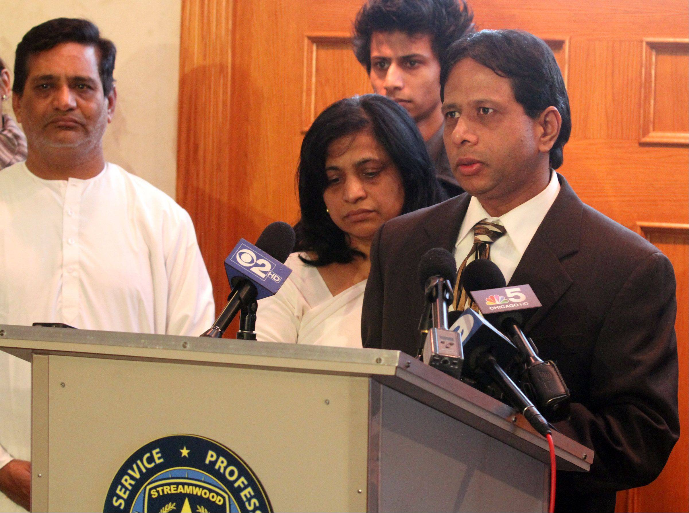Ashwin Jaiswal, a relative of Anandkumar Jaiswal, speaks during a news conference yesterday at Countryside Funeral Home in Bartlett. Streamwood Police announced an increase to $25,000 for the reward for information leading to a conviction. Anandkumar Jaiswal was stabbed to death during a robbery at a Thornton's Gas Station in Streamwood over the weekend.