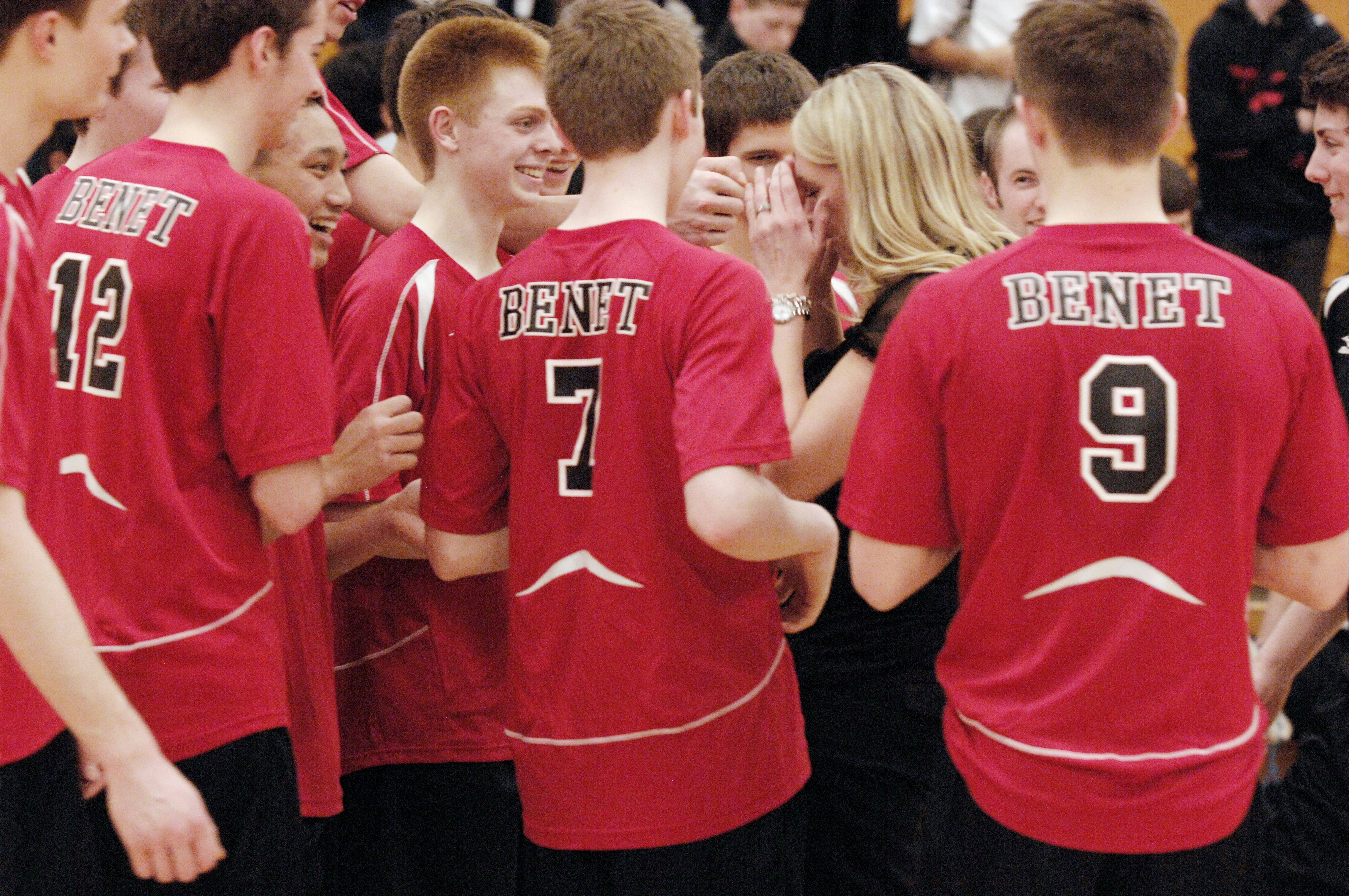 Benet Academy volleyball team congratulates their head coach, Amy Van Eekeren after she got her 500th victory with a win over Oswego East at home, Wednesday.