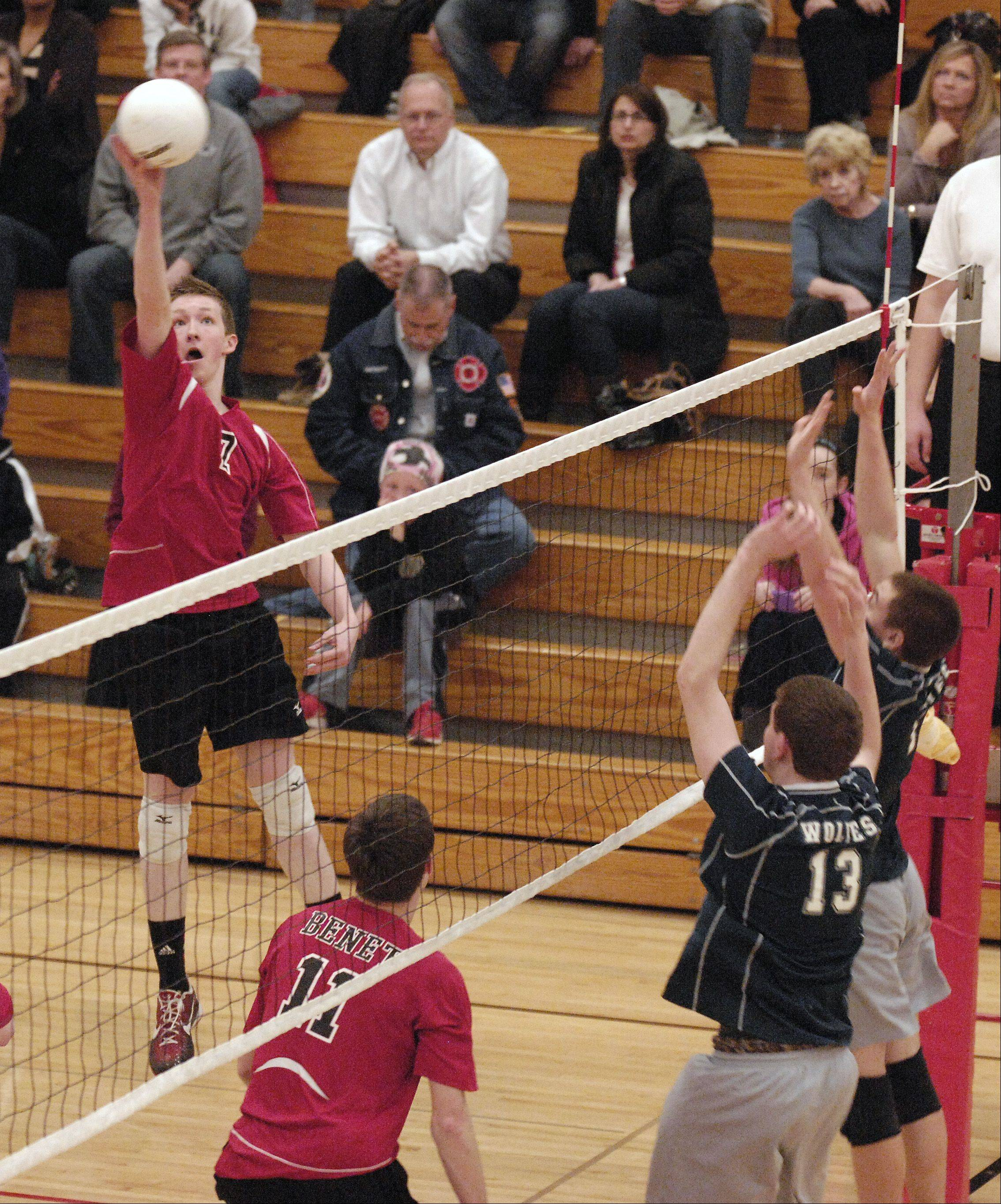 Scott Kleiser of Benet Academy fires one past Oswego East during boys varsity volleyball, Wednesday at home.
