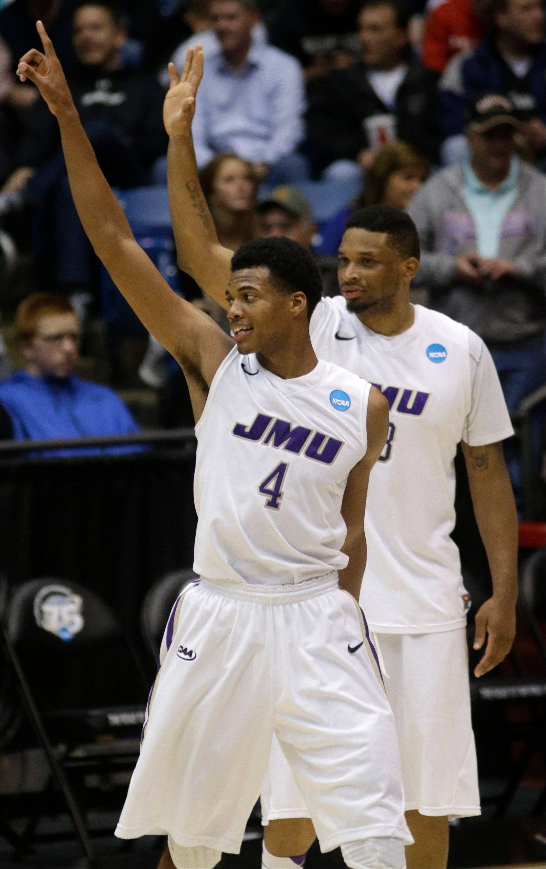 James Madison guard Charles Cooke (4) and forward Rayshawn Goins celebrate after they defeated LIU Brooklyn 68-55 in a first-round game of the NCAA college basketball tournament on Wednesday, March 20, 2013, in Dayton, Ohio.