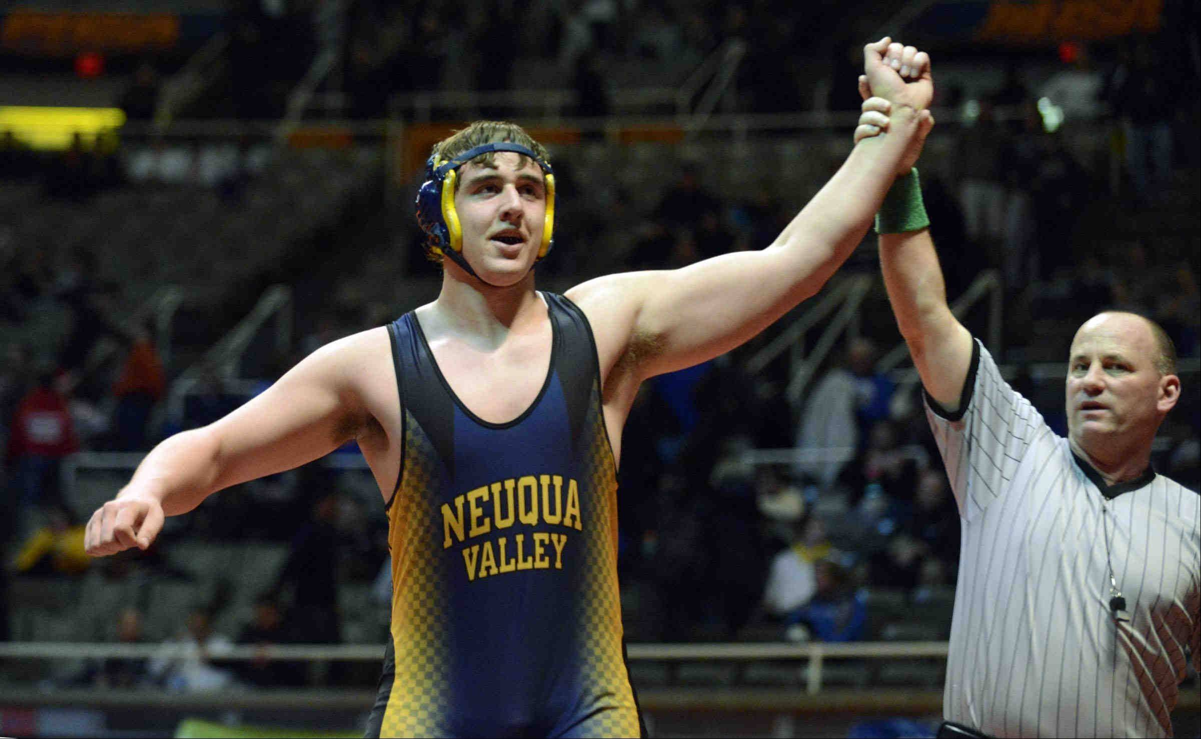 John Starks/jstarks@dailyherald.com ¬ Neuqua Valley's Andrew Geers is declared the winner of the 285 pound Class 3A match over Alex Fritz of Marmion Academy Friday in the IHSA semifinal wrestling match at Assembly Hall in Champaign.