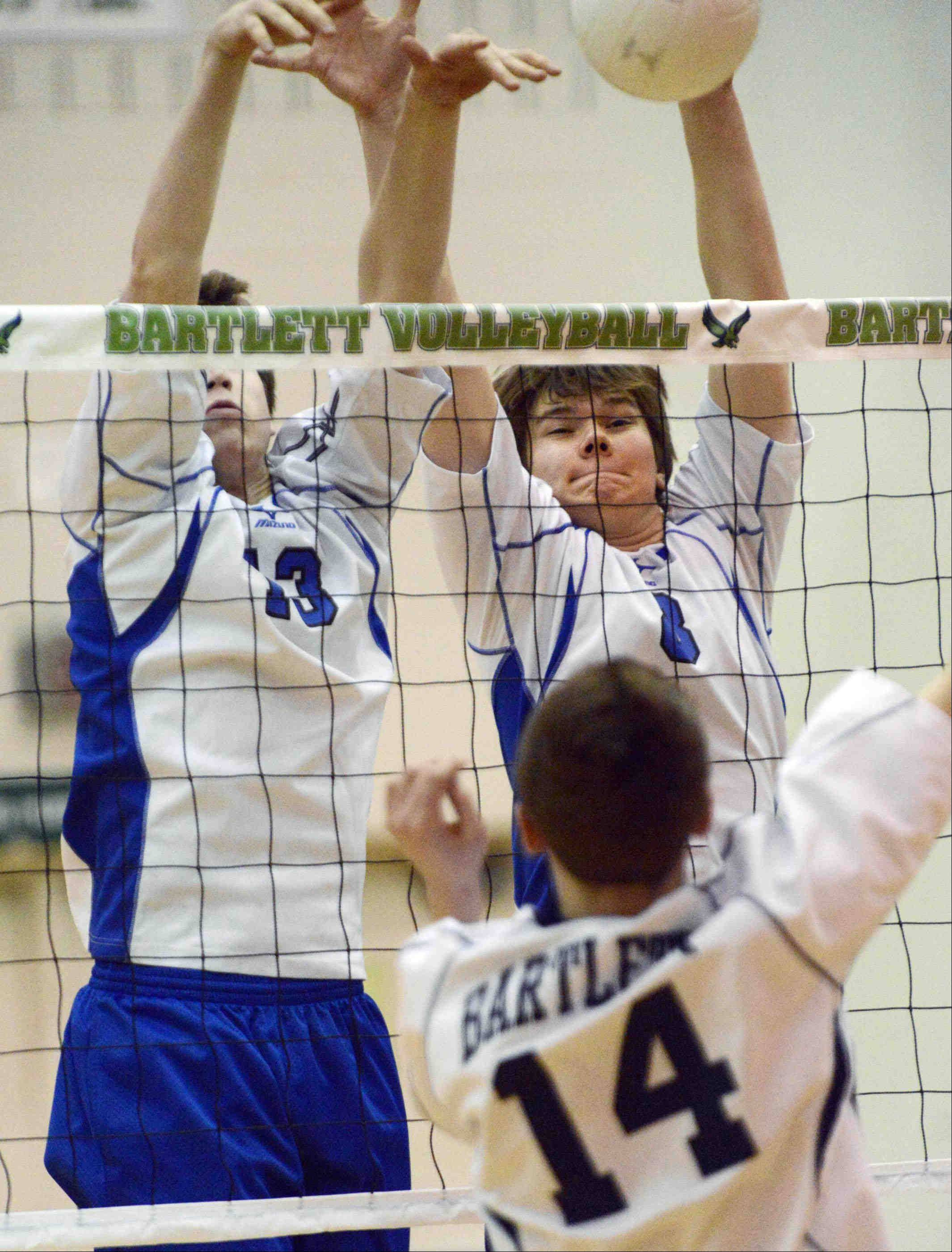 St. Francis' Matt Metzler and Mike Murphy, right, double-team a block of Bartlett's Ben Saldivar on Wednesday in Bartlett.