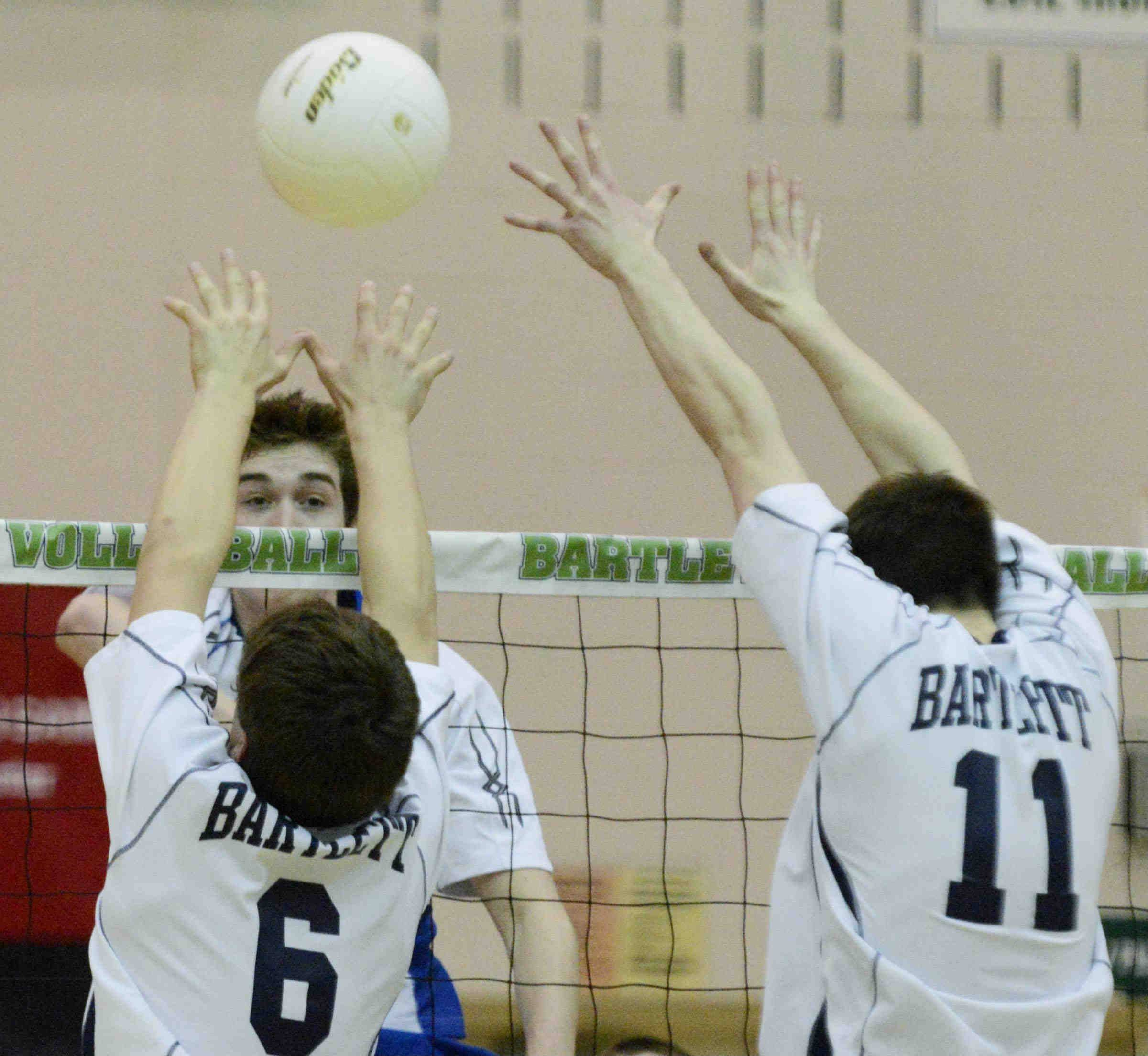 St. Francis' Matt Metzler watches his shot go past Bartlett's Jake Martin and Jack Blum on Wednesday in Bartlett.