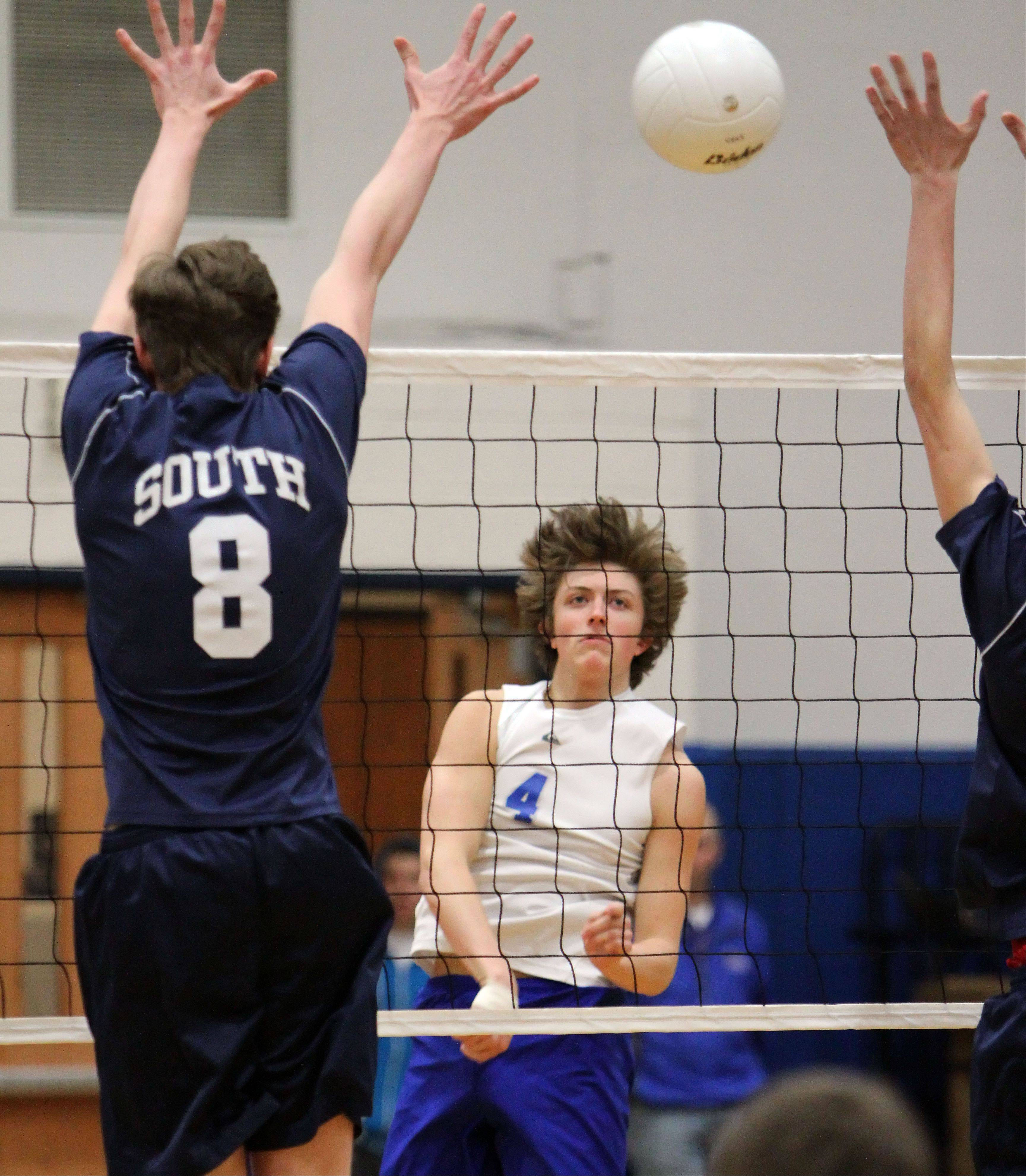 Vernon Hills' Mike Heinz, right, spikes the ball past Glenbrook South's Pawel Rafalo on Wednesday night at Vernon Hills.