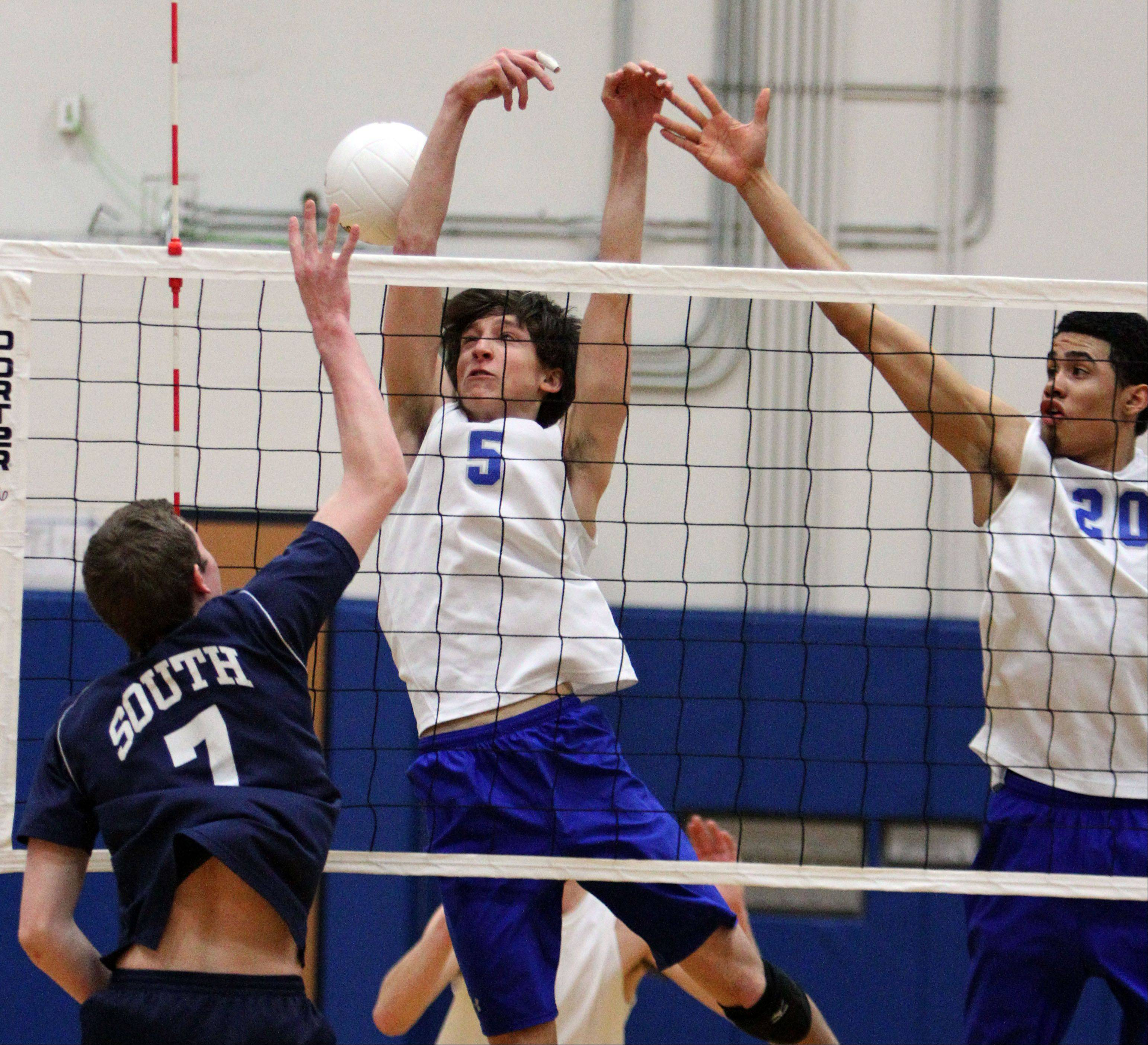 Vernon Hills' Max Spiglanin, left and Lem Turner block the spike attempt by Glenbrook South's Will Kozloski on Wednesday night at Vernon Hills.