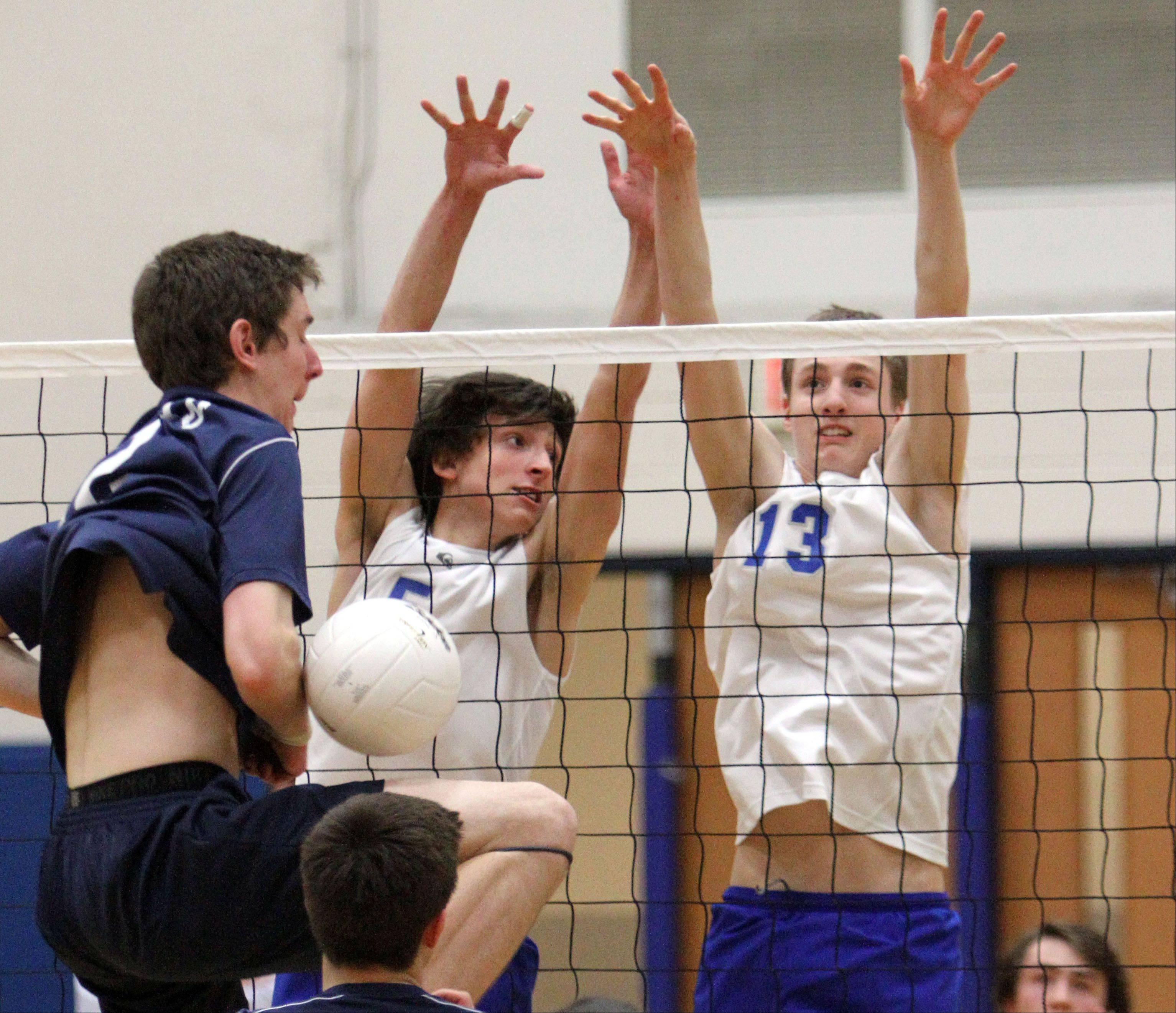 Vernon Hills' Max Spiglanin, left, and Tyler Small block the spike attempt by Glenbrook South's Anthony Lebryk on Wednesday night at Vernon Hills.