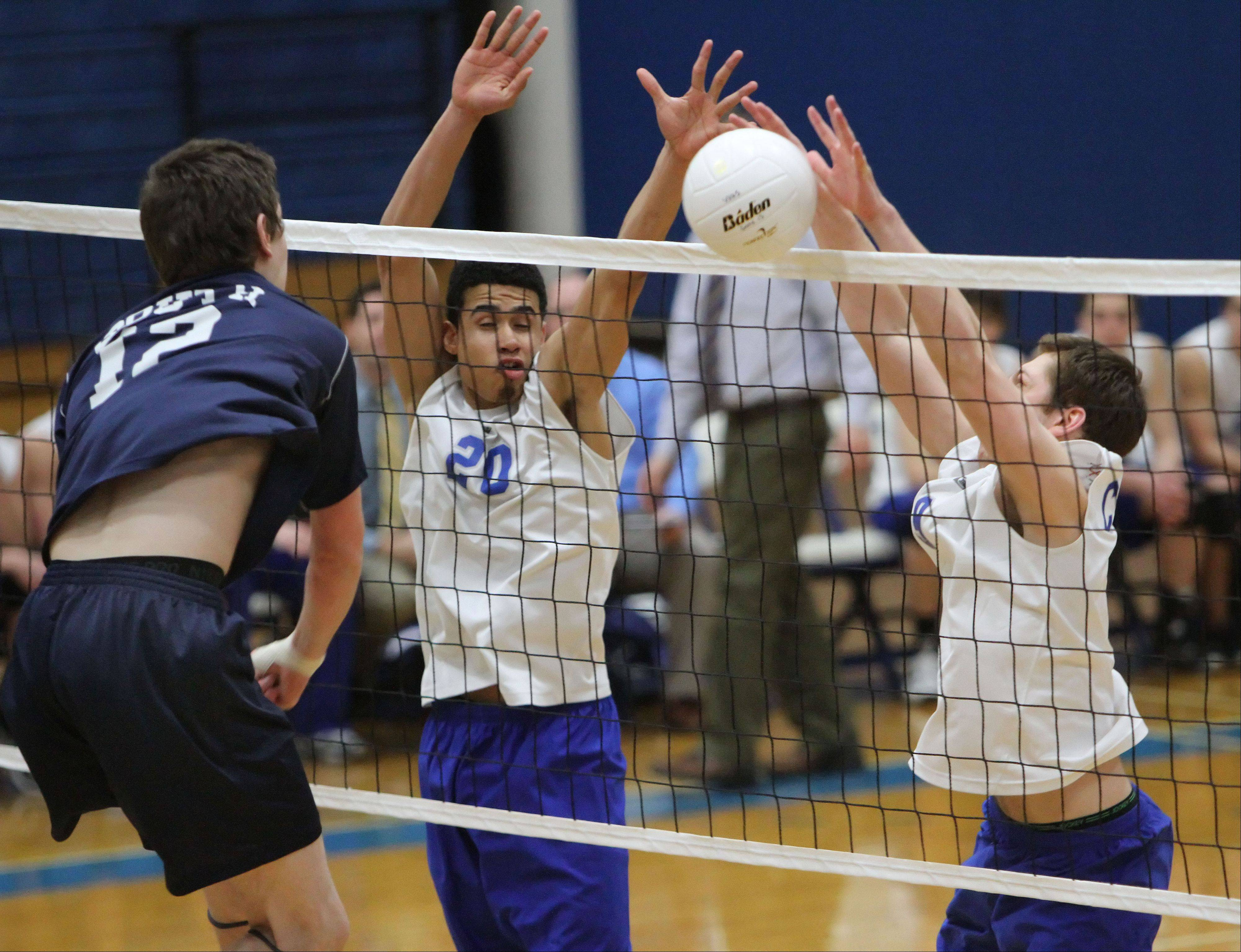 Vernon Hills' Lem Turner, left and Danny Rosenstock block the spike attempt by Glenbrook South's Anthony Lebryk during their game Wednesday night at Vernon Hills.