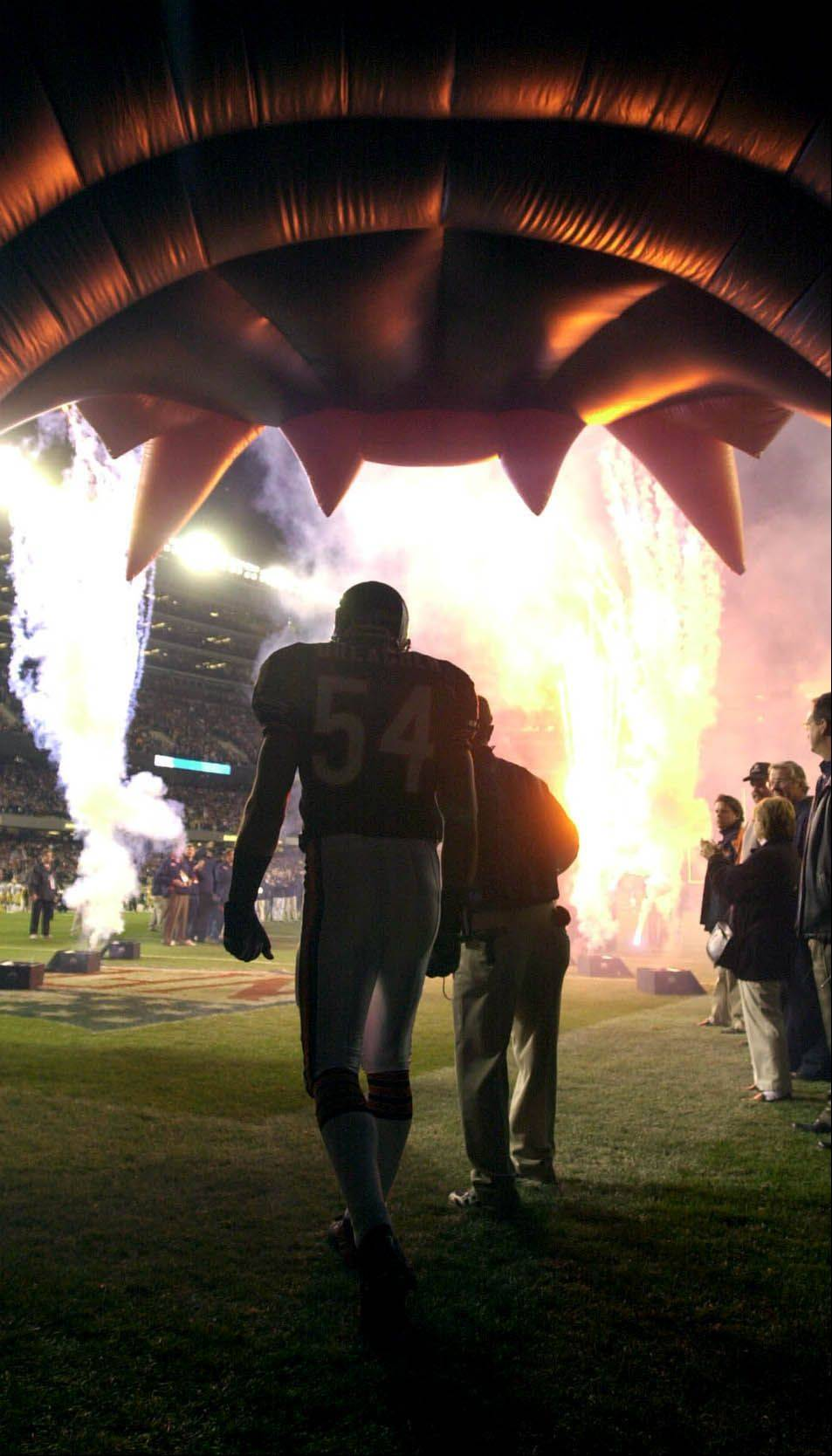 Brian Urlacher prepares to enter the field for the home opener.